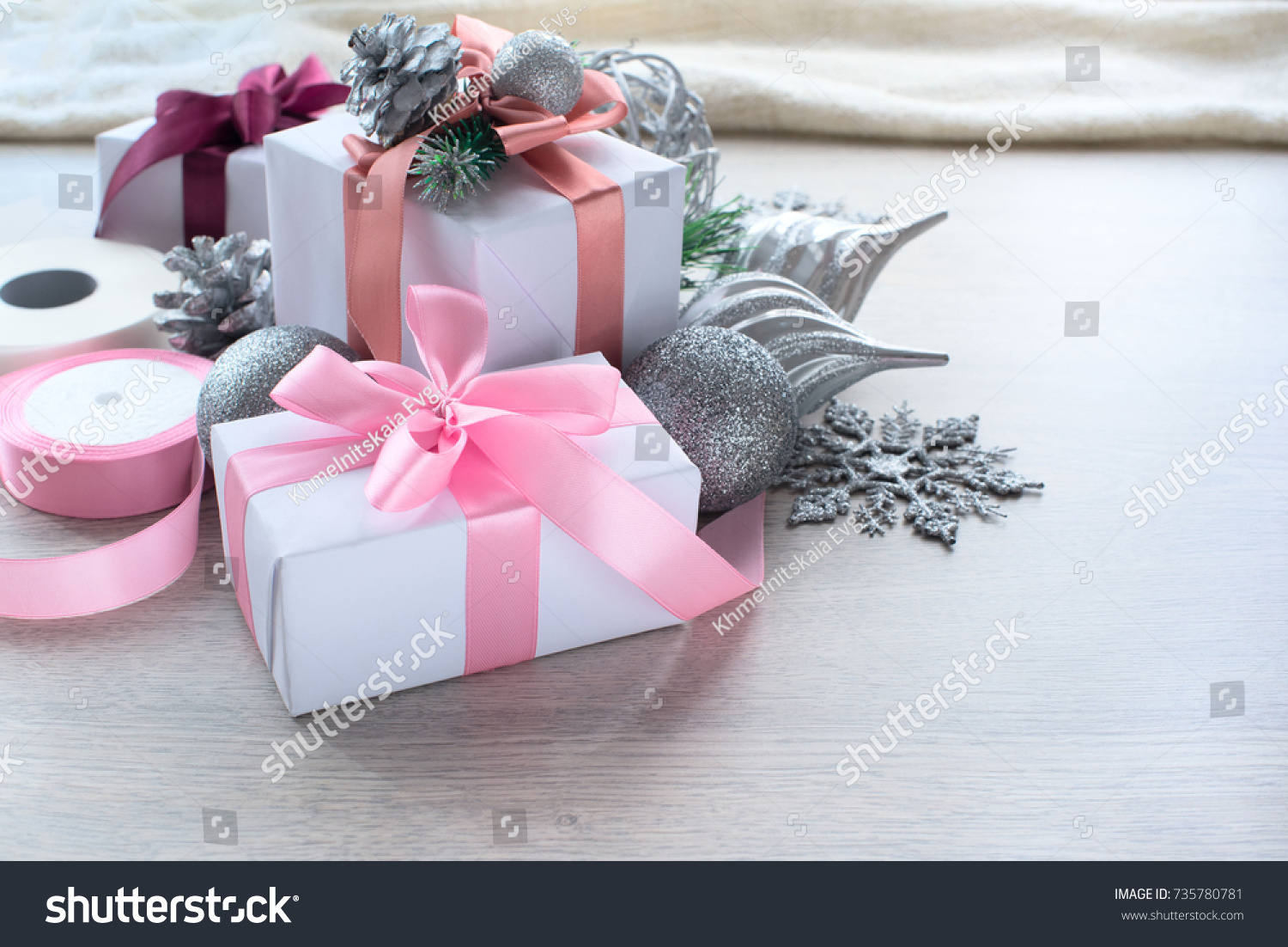 Christmas elegant composition Gift box in silver paper with a pink ...