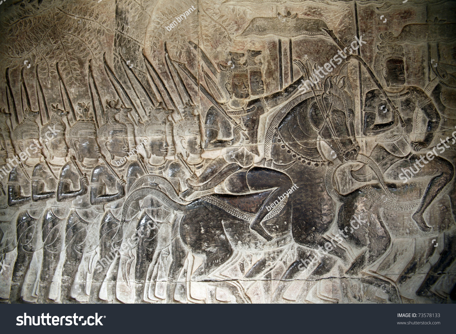 The stone carvings bas relief of angkor wat temple in siem