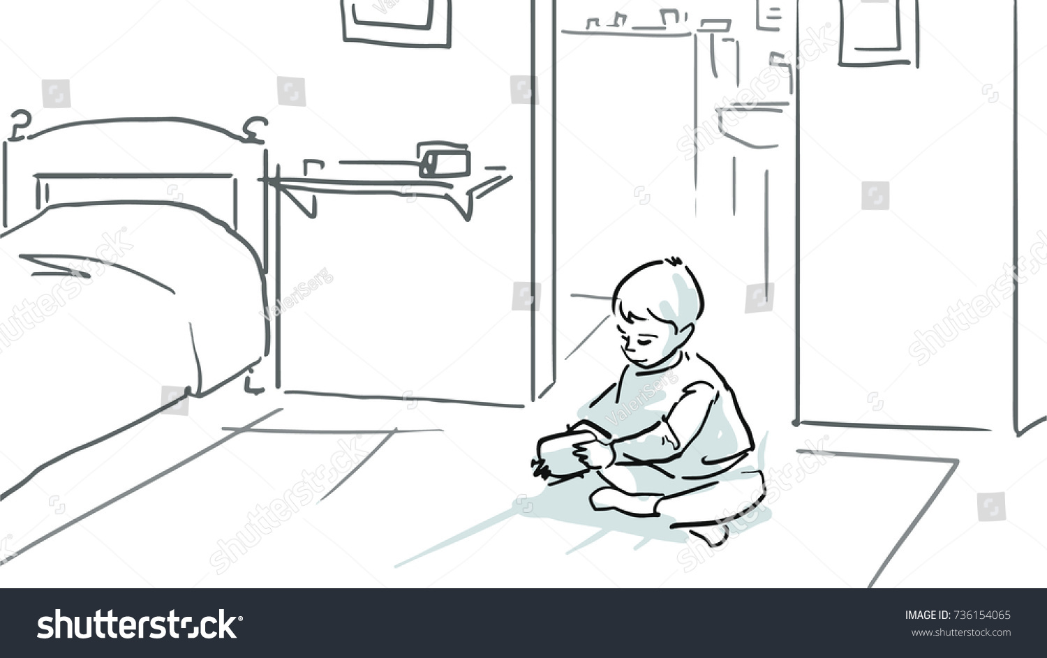 A little boy is sitting on a floor in a room and playing black and white