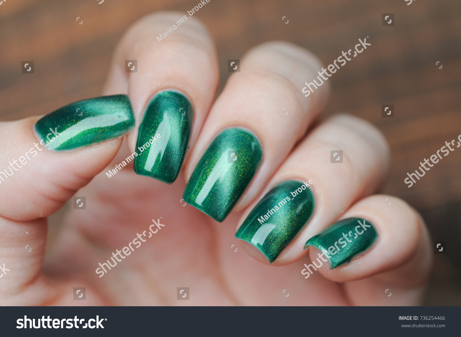 Green Color Cats Eye Manicure Nail Stock Photo (Safe to Use ...