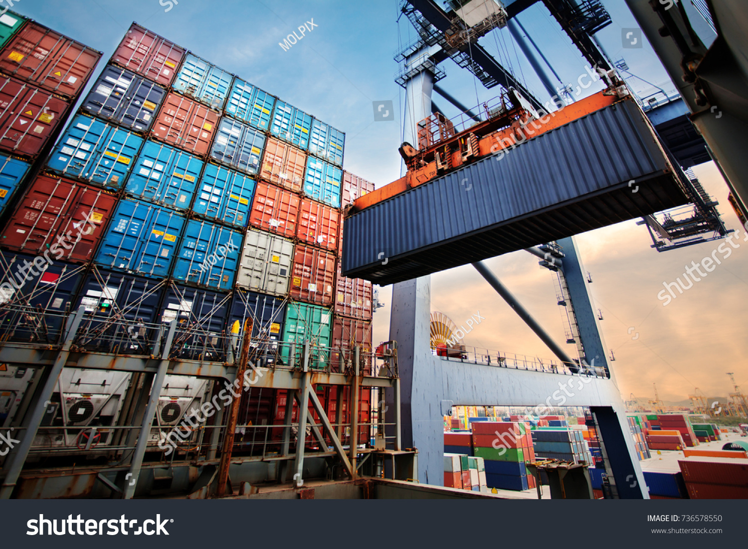Container loading in a Cargo freight ship with industrial crane. Container ship in import and export business logistic company. Industry and Transportation concept. #736578550