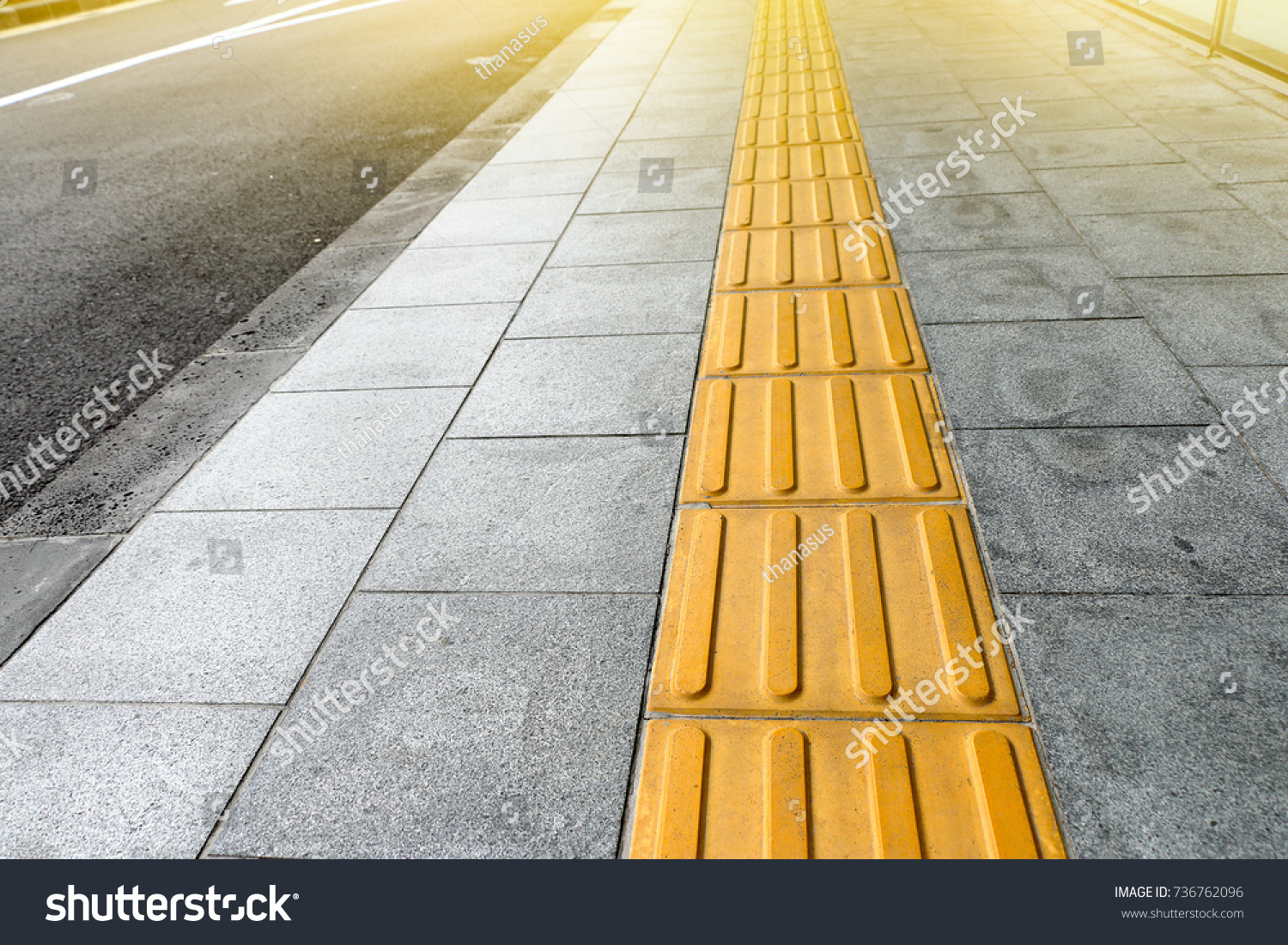 Tactile paving blind handicap on tiles stock photo 736762096 tactile paving for blind handicap on tiles pathway walkway for blindness people dailygadgetfo Image collections
