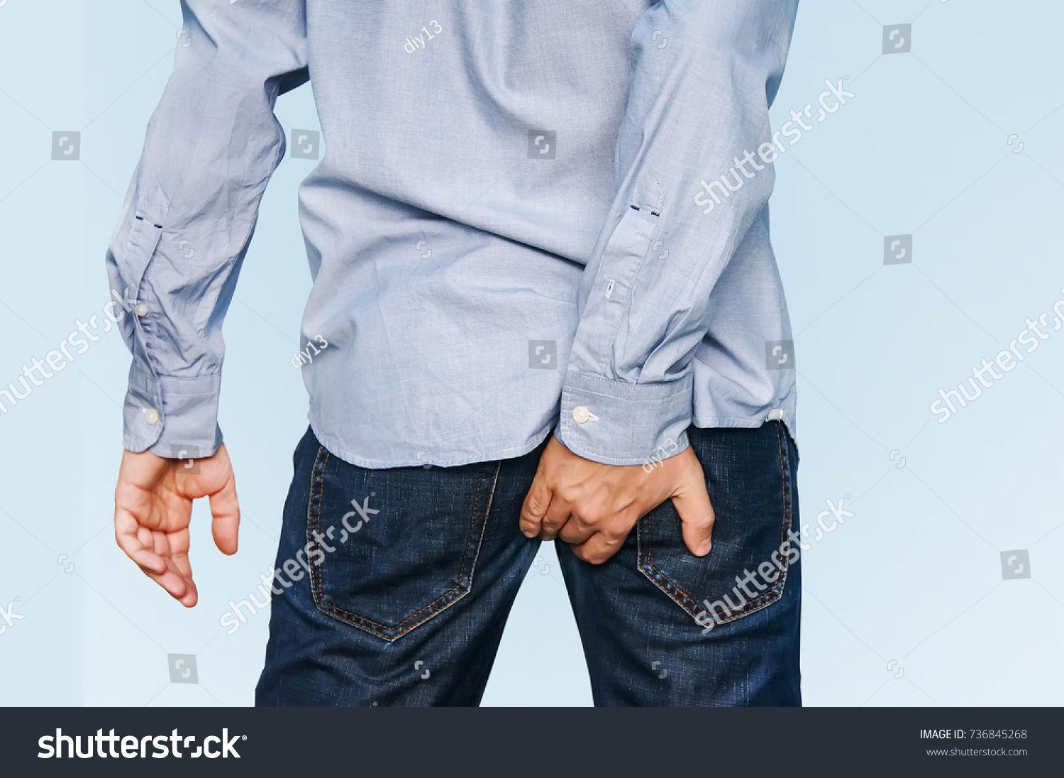 Man has Diarrhea Holding his Butt. Guy to hold with a hand a sore ass