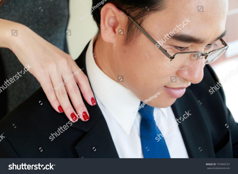beautiful secretary massage her boss his stock photo (royalty free
