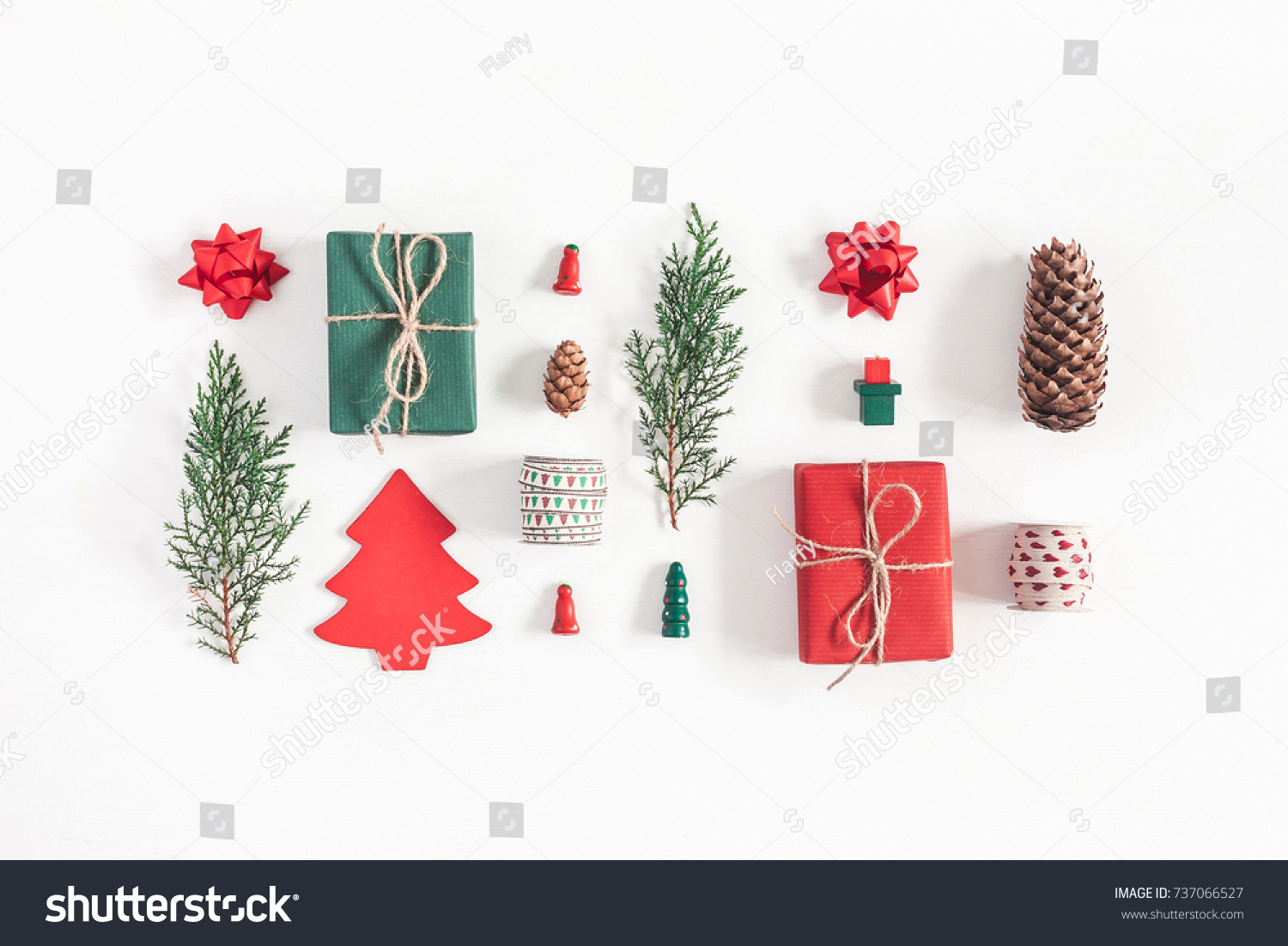 Christmas composition. Christmas gifts, pine branches, toys on white background. Flat lay, top view. #737066527