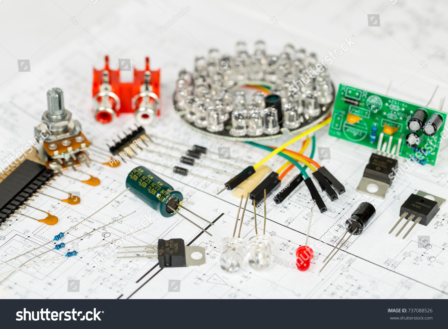 Electronic components over electronic diagram, printed wiring, transistors,  integrated circuits, capacitors,