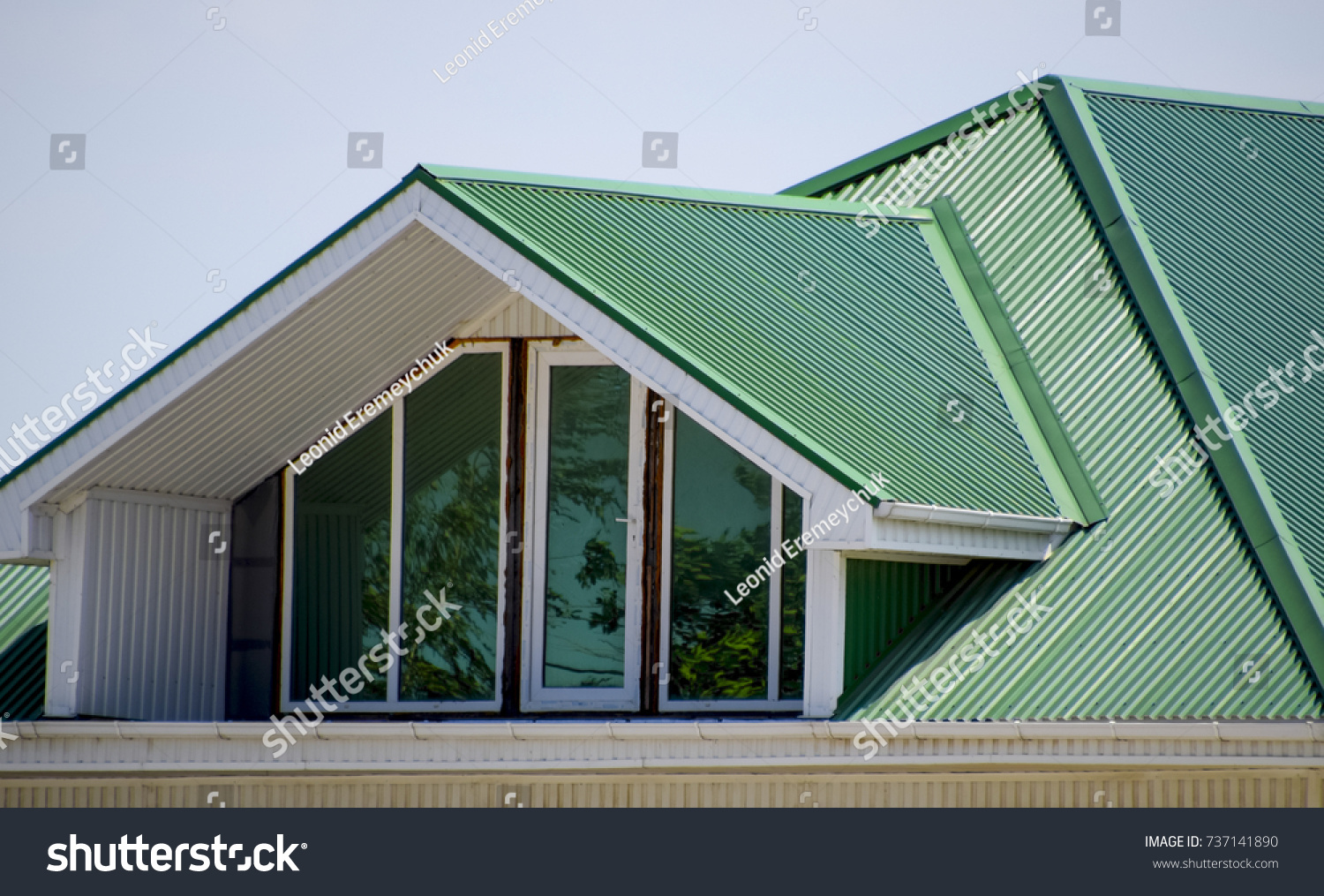 House plastic windows green roof corrugated stock photo 737141890 the house with plastic windows and a green roof of corrugated sheet roofing of metal sciox Image collections
