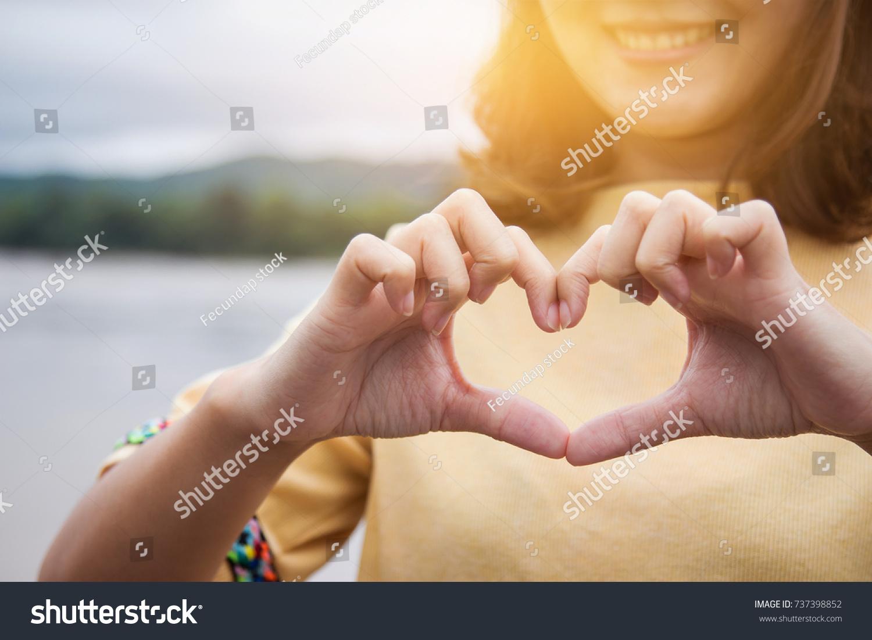 Girl Hand Make Heart Sign Happy Stock Photo 737398852 - Shutterstock
