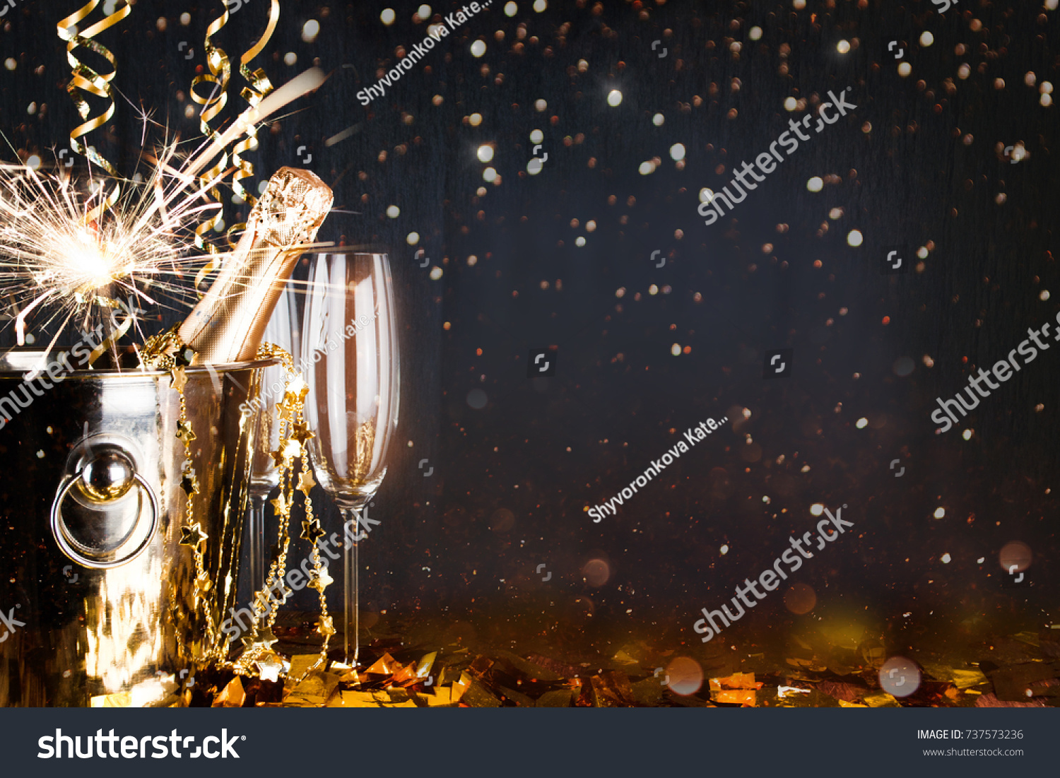 New years eve celebration background with champagne. New Years Eve celebration background with pair of flutes and bottle of champagne  #737573236