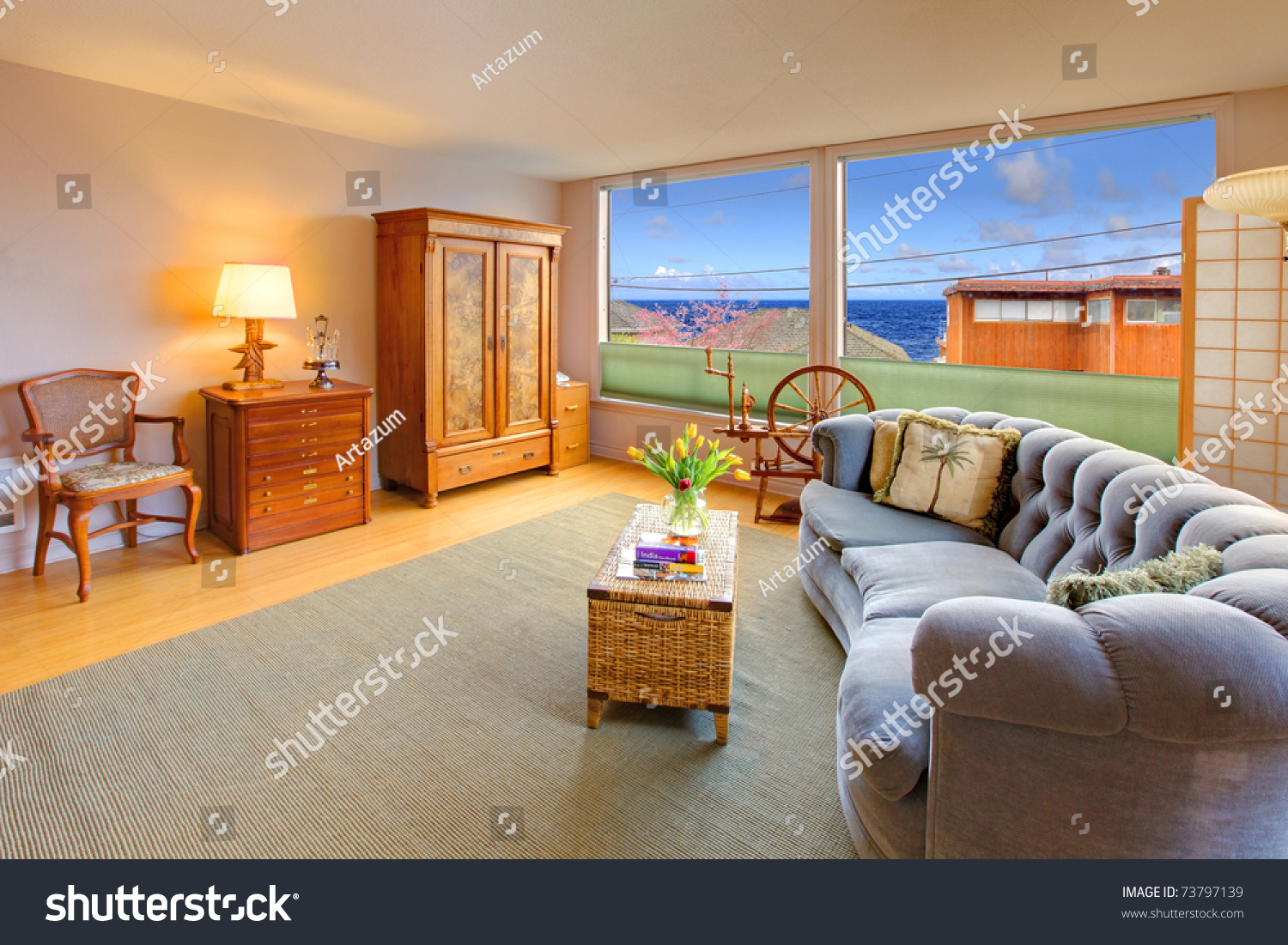 living room with antique furniture and blue sofa stock photo 73797139 shutterstock. Black Bedroom Furniture Sets. Home Design Ideas