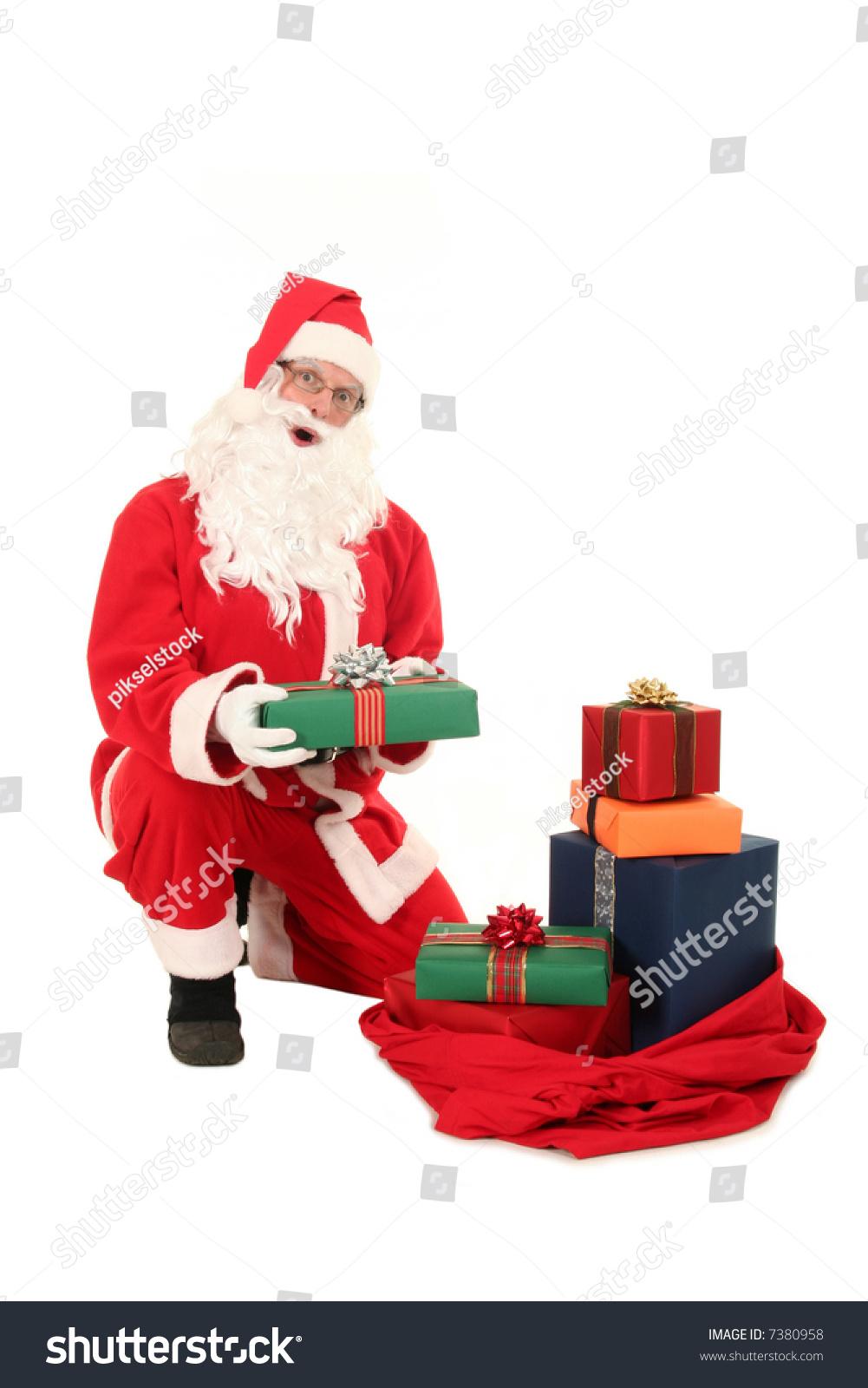 Santa claus and christmas gifts stock photo