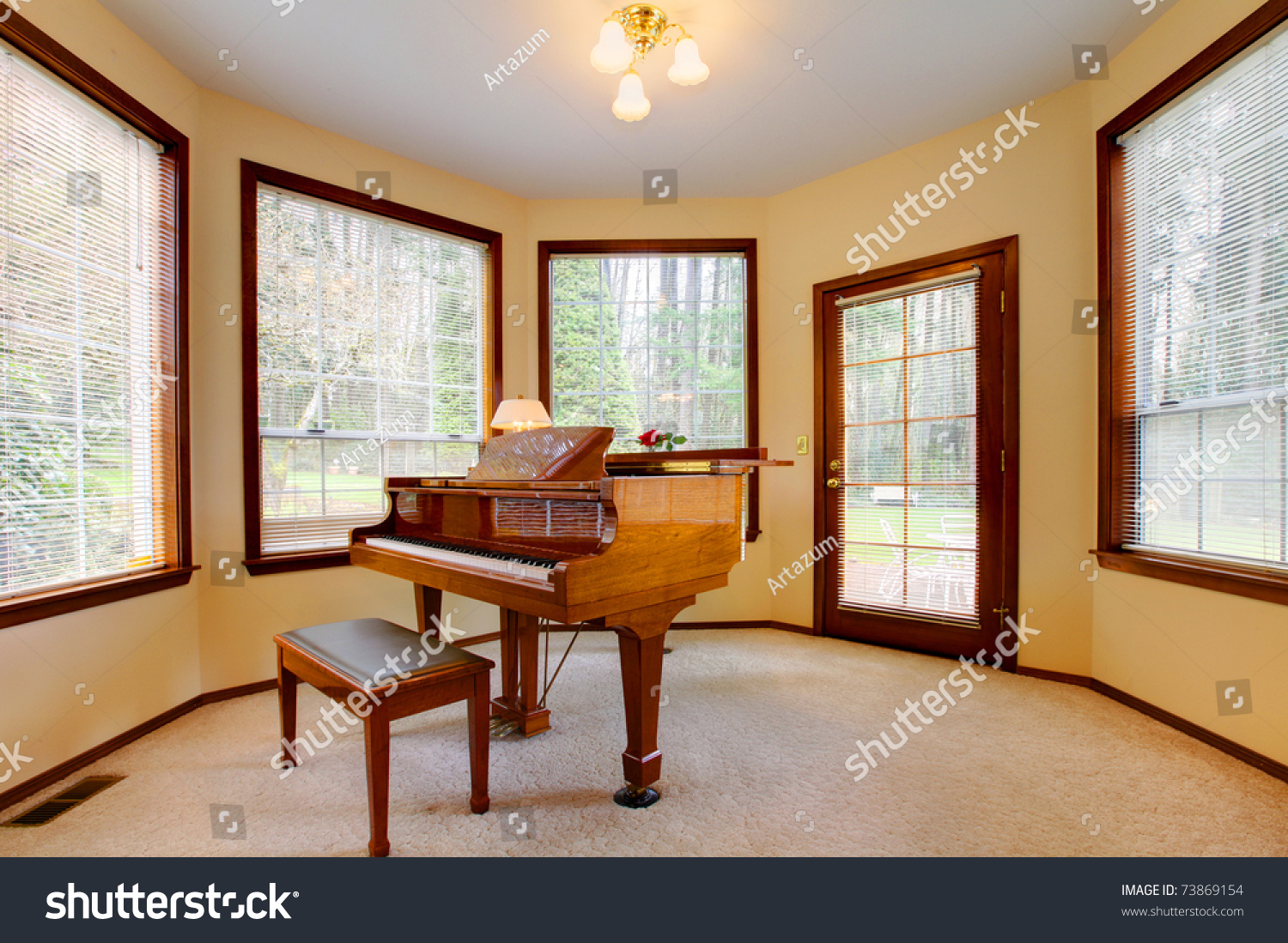 Piano Room With Yellow Walls And Many Windows Stock Photo