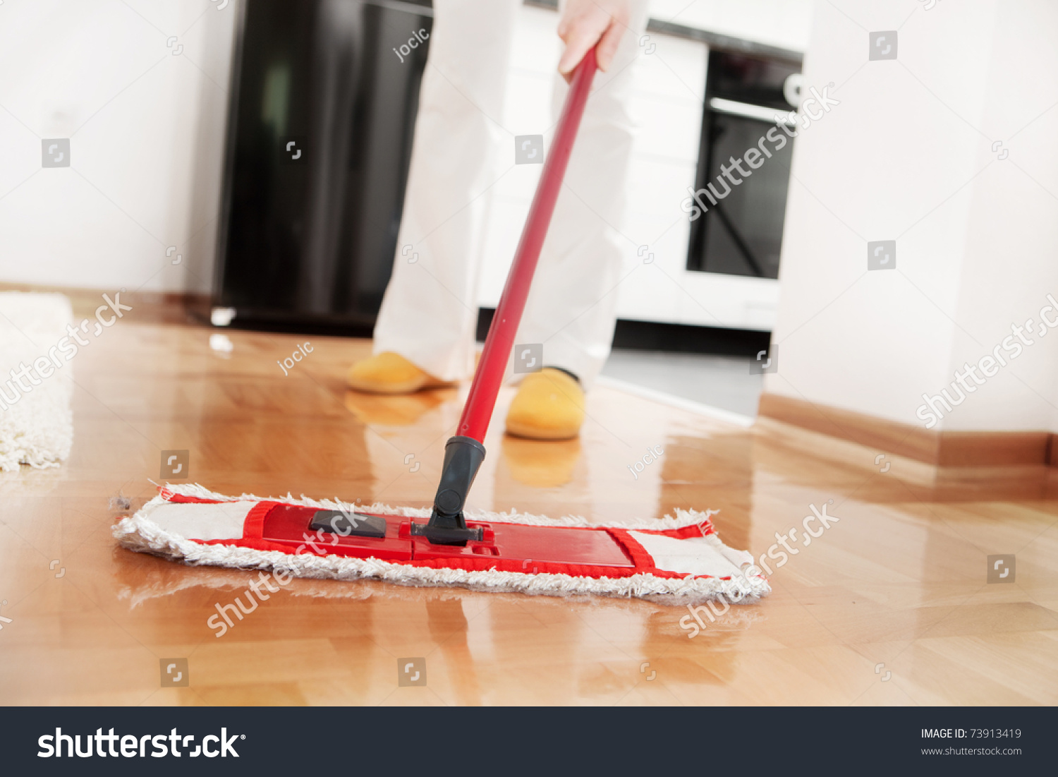 House cleaning mopping hardwood floor stock photo for House cleaning stock photos