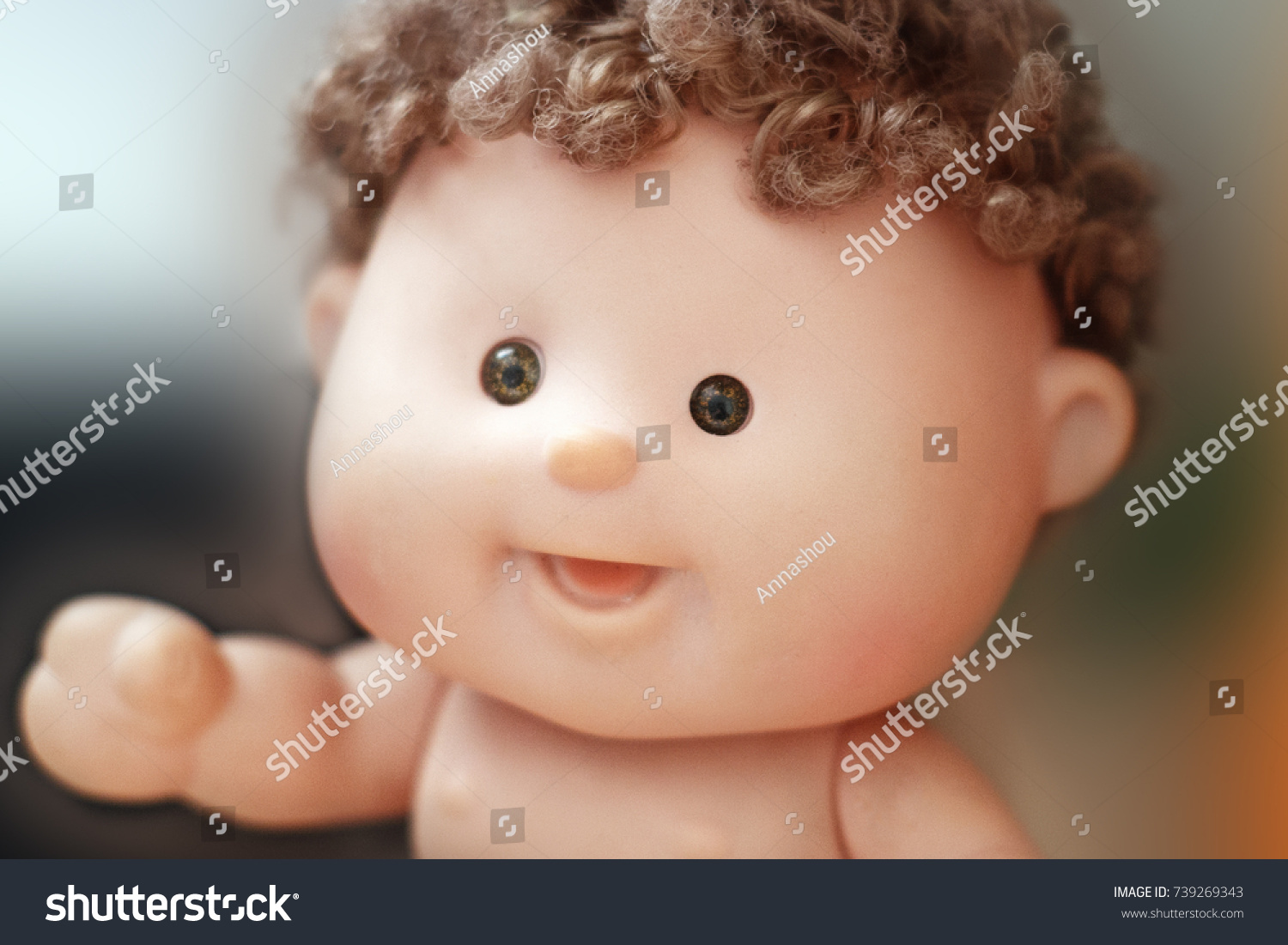 Cute baby doll with small curls and fat cheeks