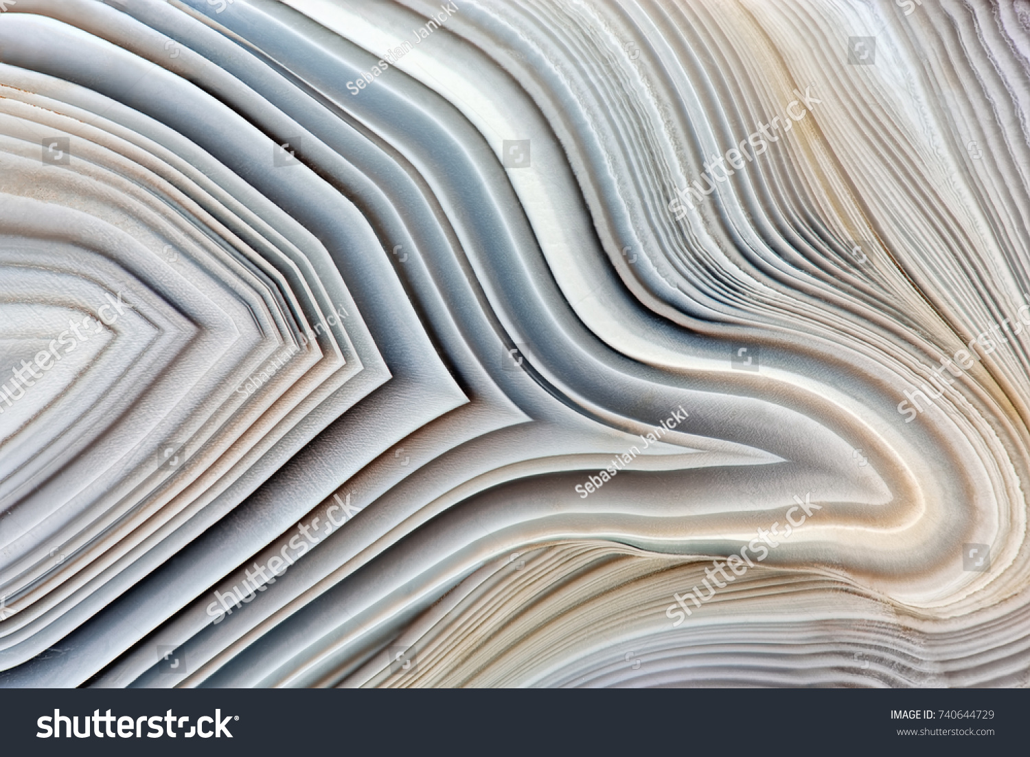 Amazing Banded Agate Crystal cross section as a background. Natural light translucent agate crystal surface, Gray abstract expressive structure slice mineral stone macro closeup #740644729 - 123PhotoFree.com