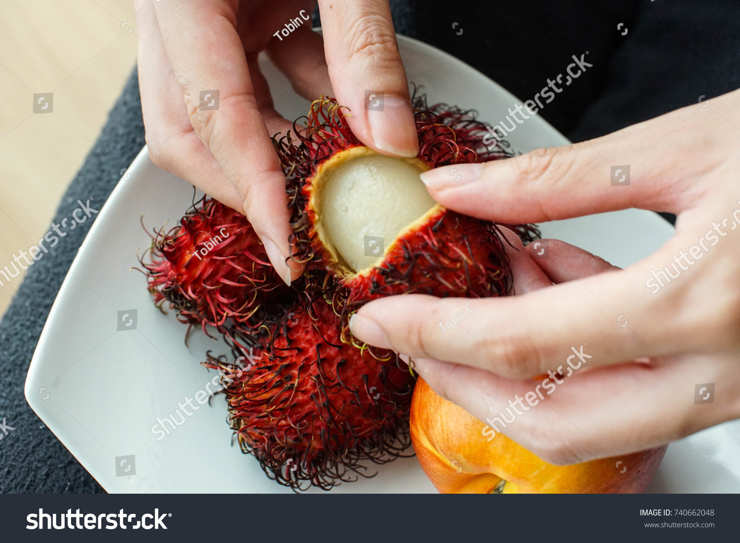 peeling hairy skin exotic asian fruit stock photo (royalty free