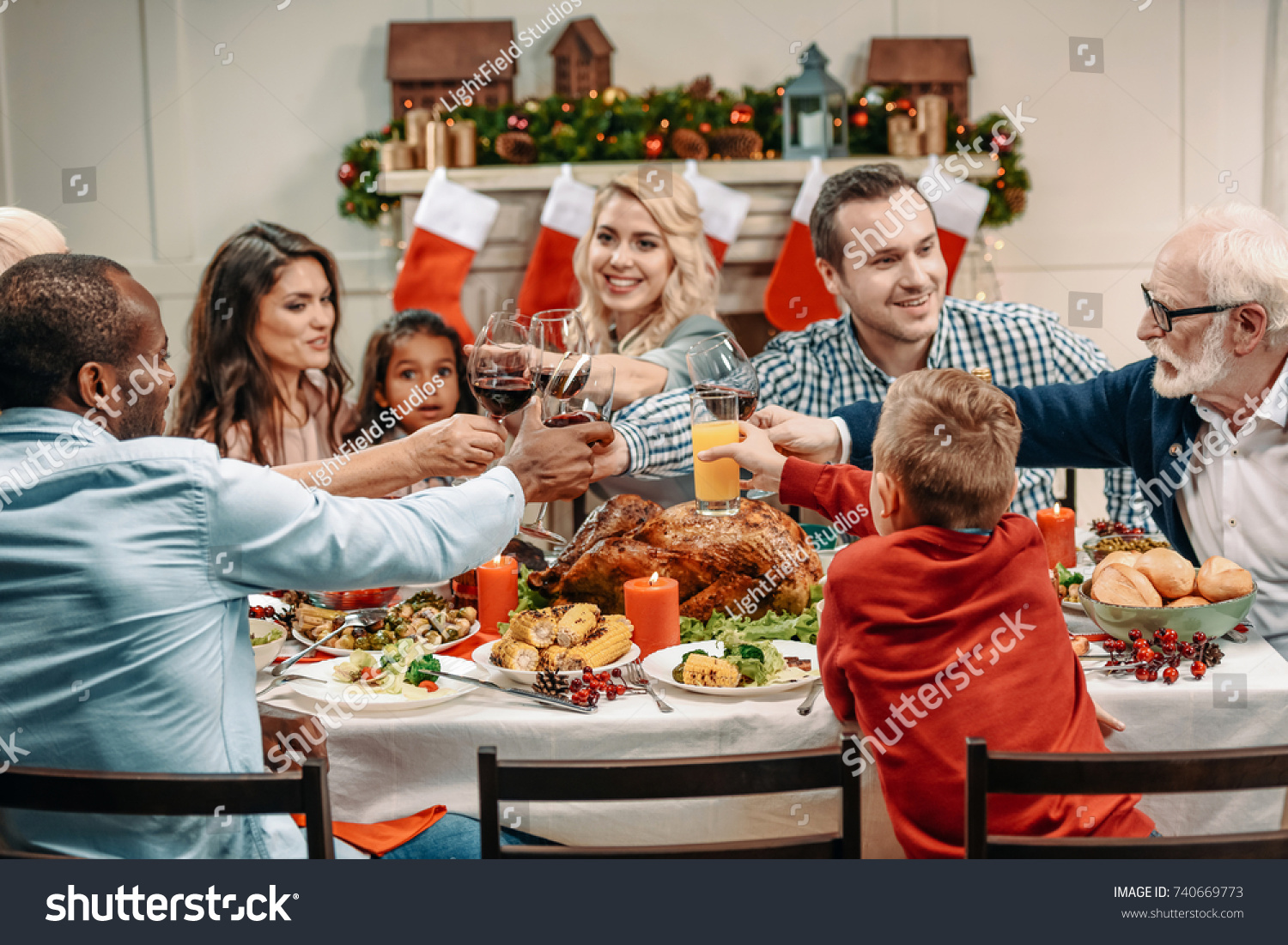 Family Clinking Glasses While Having Christmas Dinner