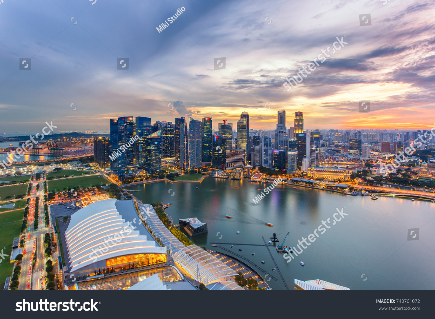 Aerial view of Singapore business district and city at twilight in Singapore. #740761072