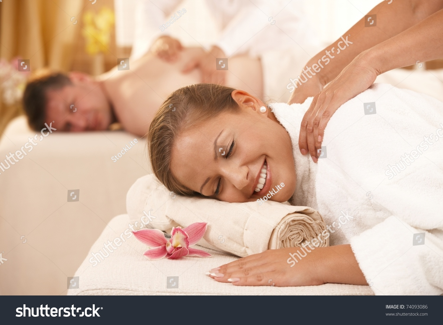 Happy Couple Having Back Massage In Day Spa. Stock Photo ...