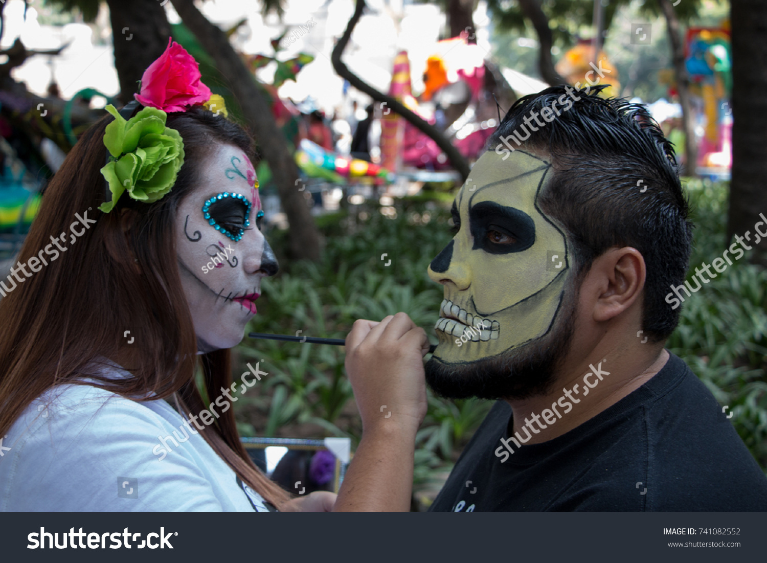 MEXICO CITY, MEXICO - OCTOBER 22, 2017: makeup artist face painting a man