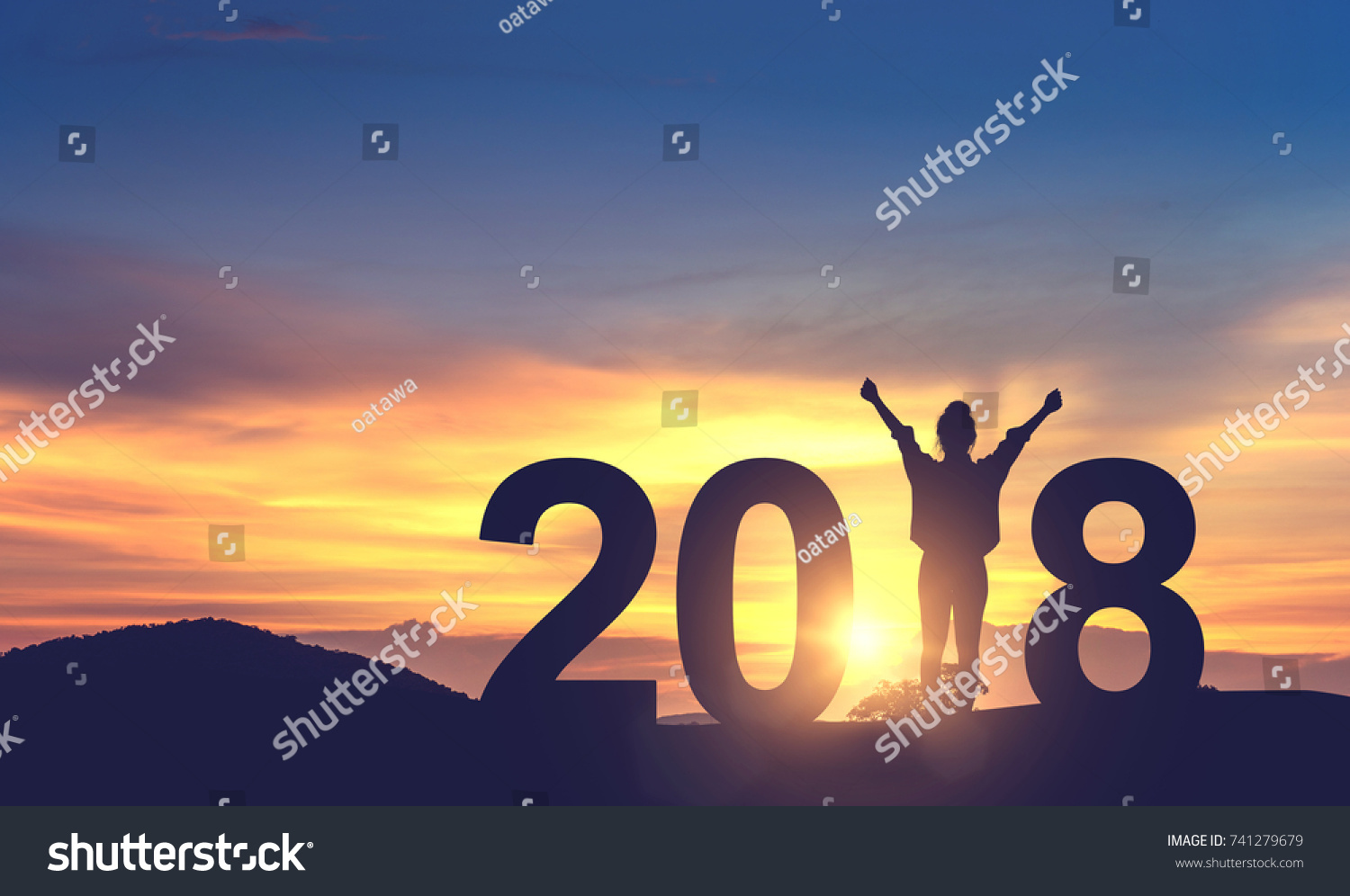 Silhouette freedom young woman Enjoying on the hill and 2018 years while celebrating new year, copy spce. #741279679