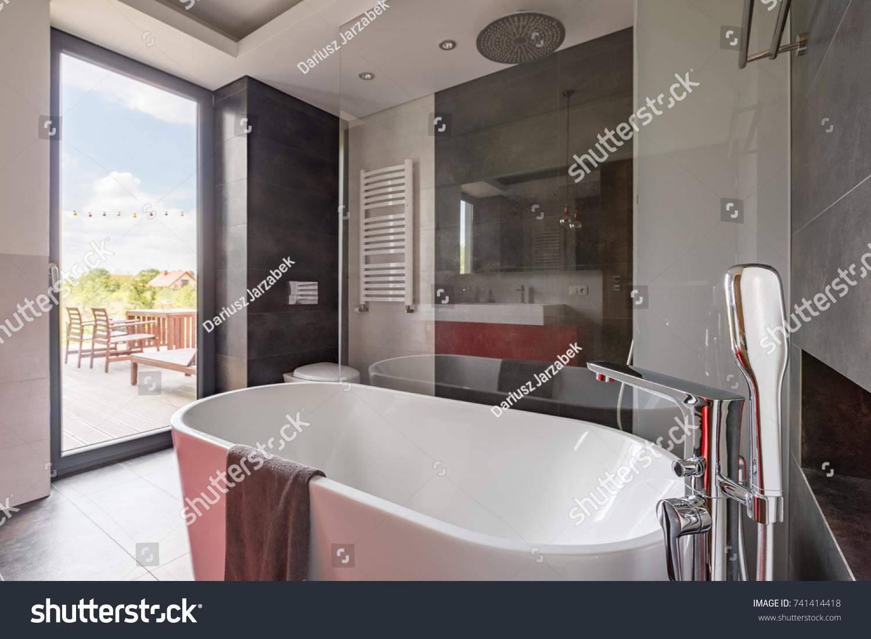 tiled bathroom with double basin and bathtub | EZ Canvas