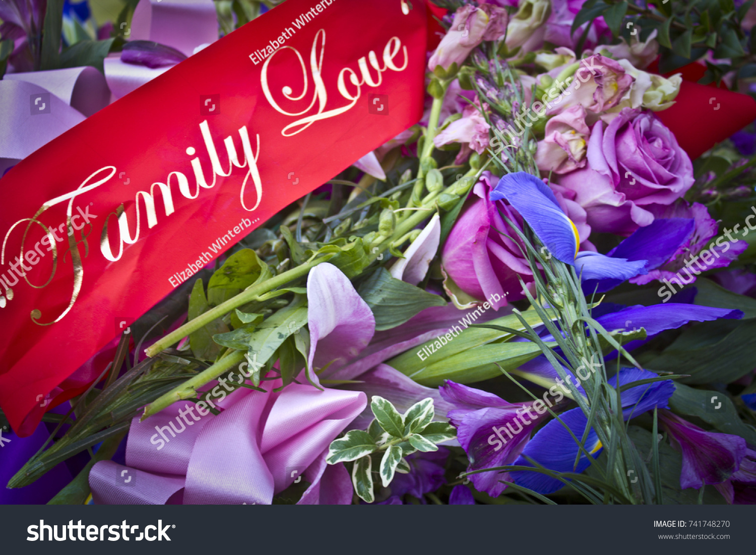 Funeral flowers red family love banner stock photo royalty free funeral flowers with red family love banner izmirmasajfo