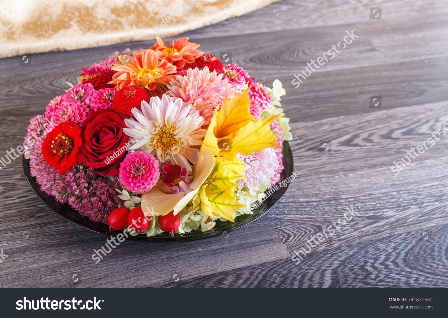 Floral arrangement autumn flowers on plate stock photo royalty free floral arrangement of autumn flowers on a plate dahlia zinnia rose orchid izmirmasajfo
