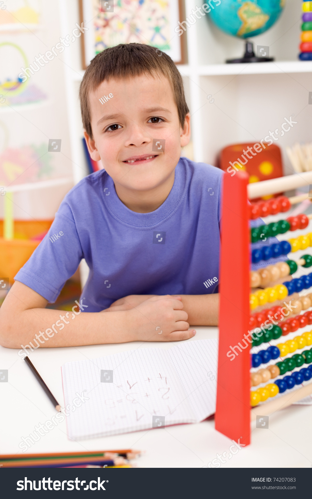 Happy Boy Solving Math Exercises In His Room Stock Photo