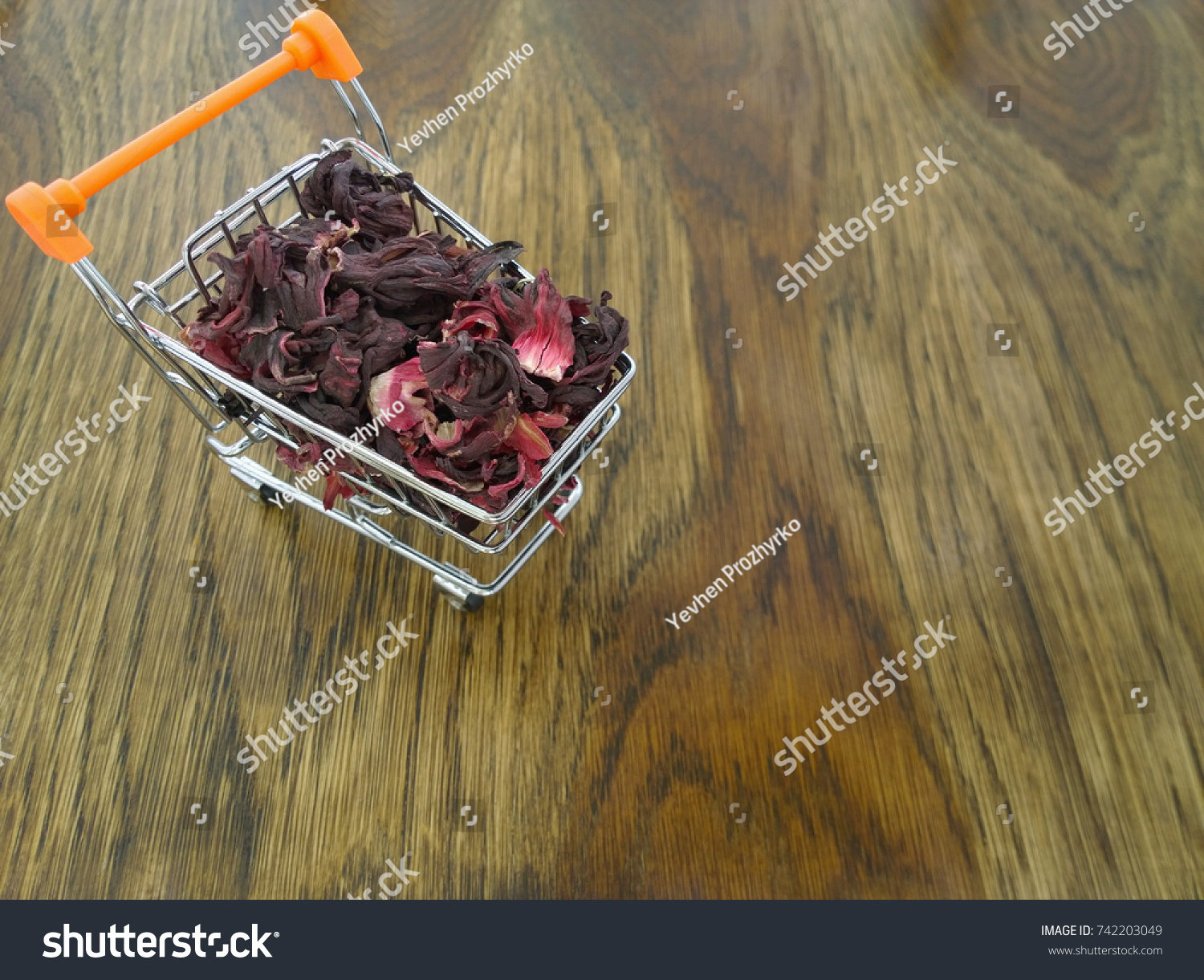 Dried hibiscus flower leaves red carcade stock photo royalty free dried hibiscus flower leaves of red carcade tea in small supermarket shopping trolley selective izmirmasajfo