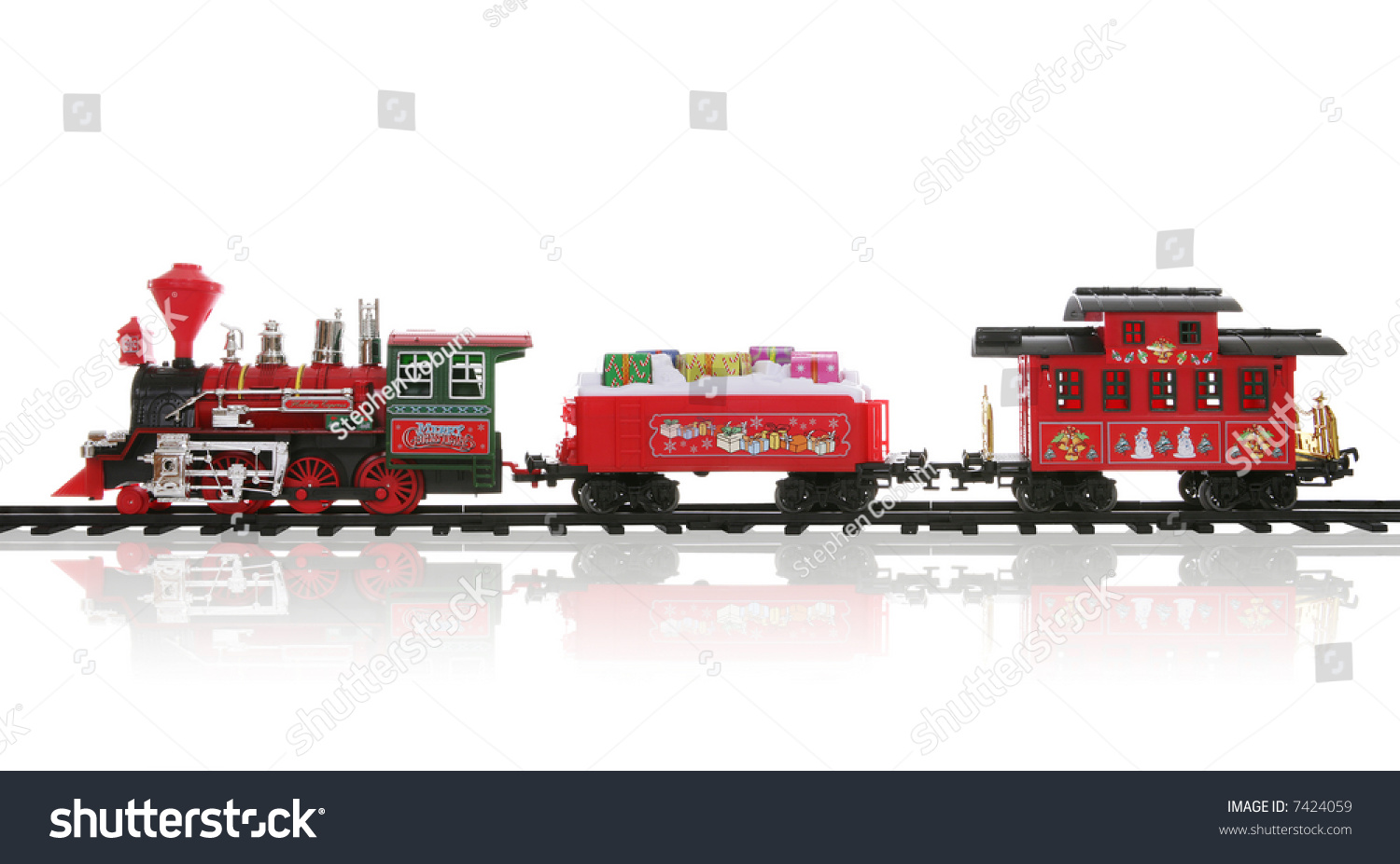 Colorful holiday christmas train over white stock photo