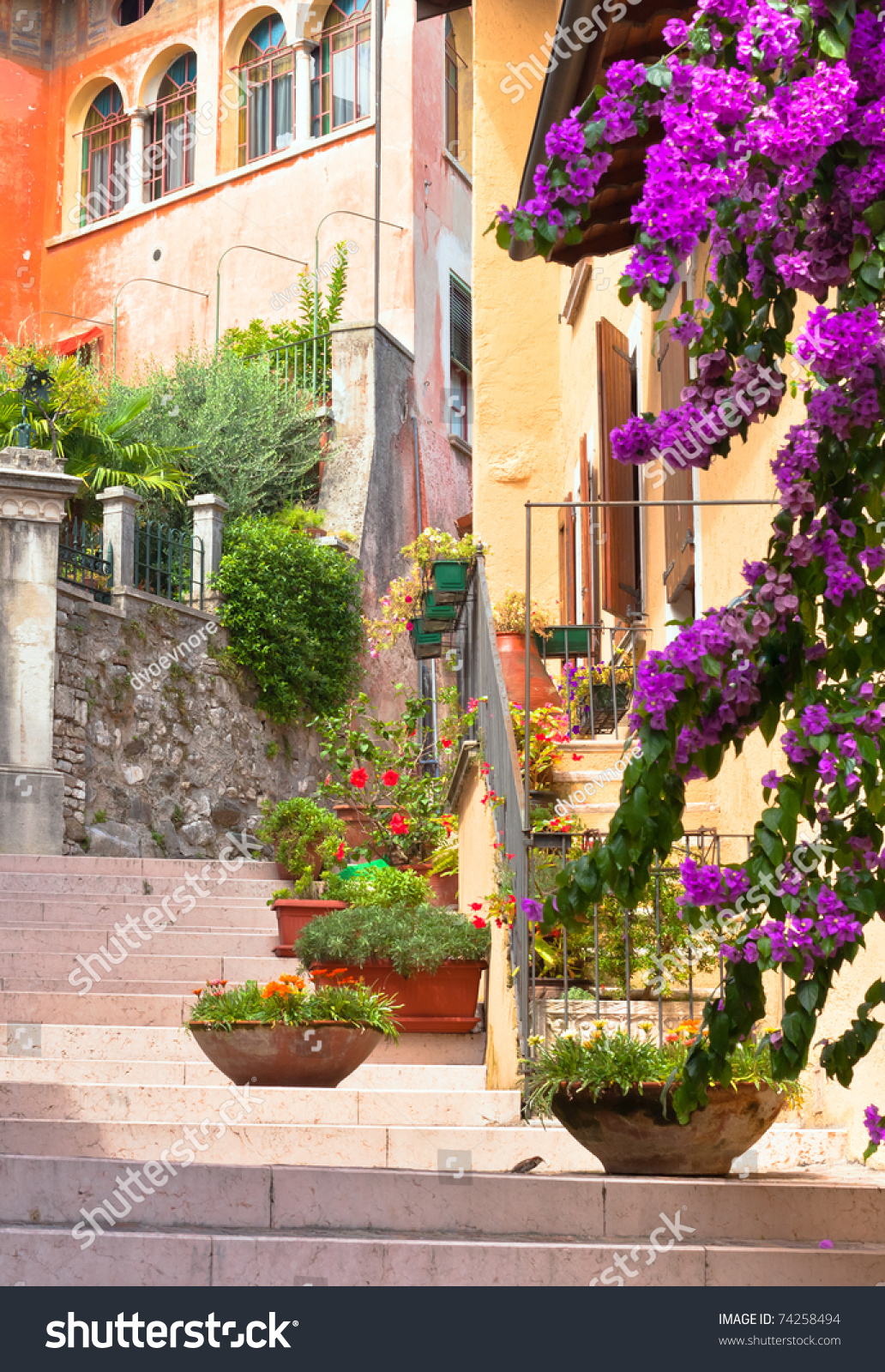 Traditional Italian Small Town Street With Pots Of Flowers