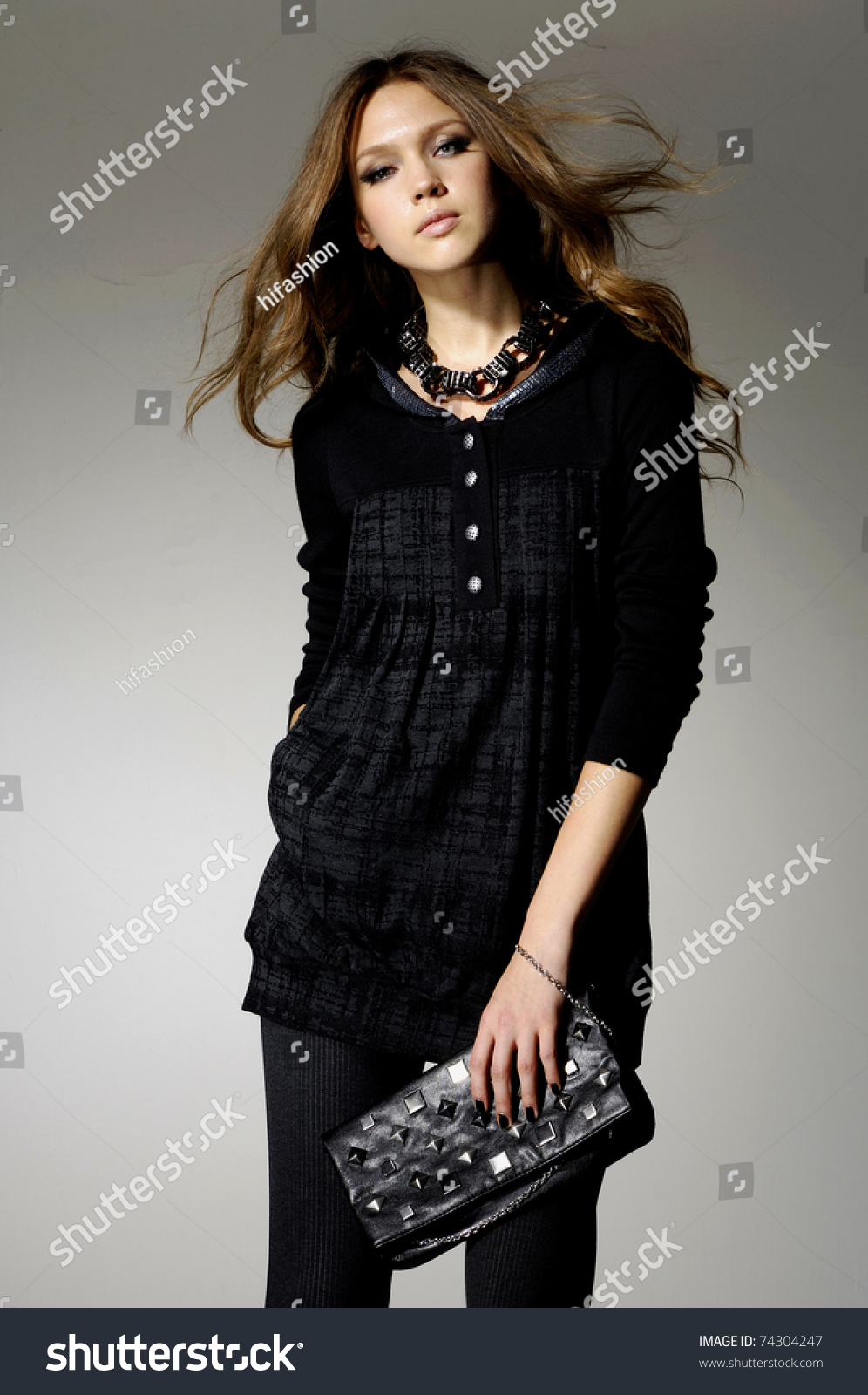 High fashion model with bag posing stock photo 74304247 shutterstock