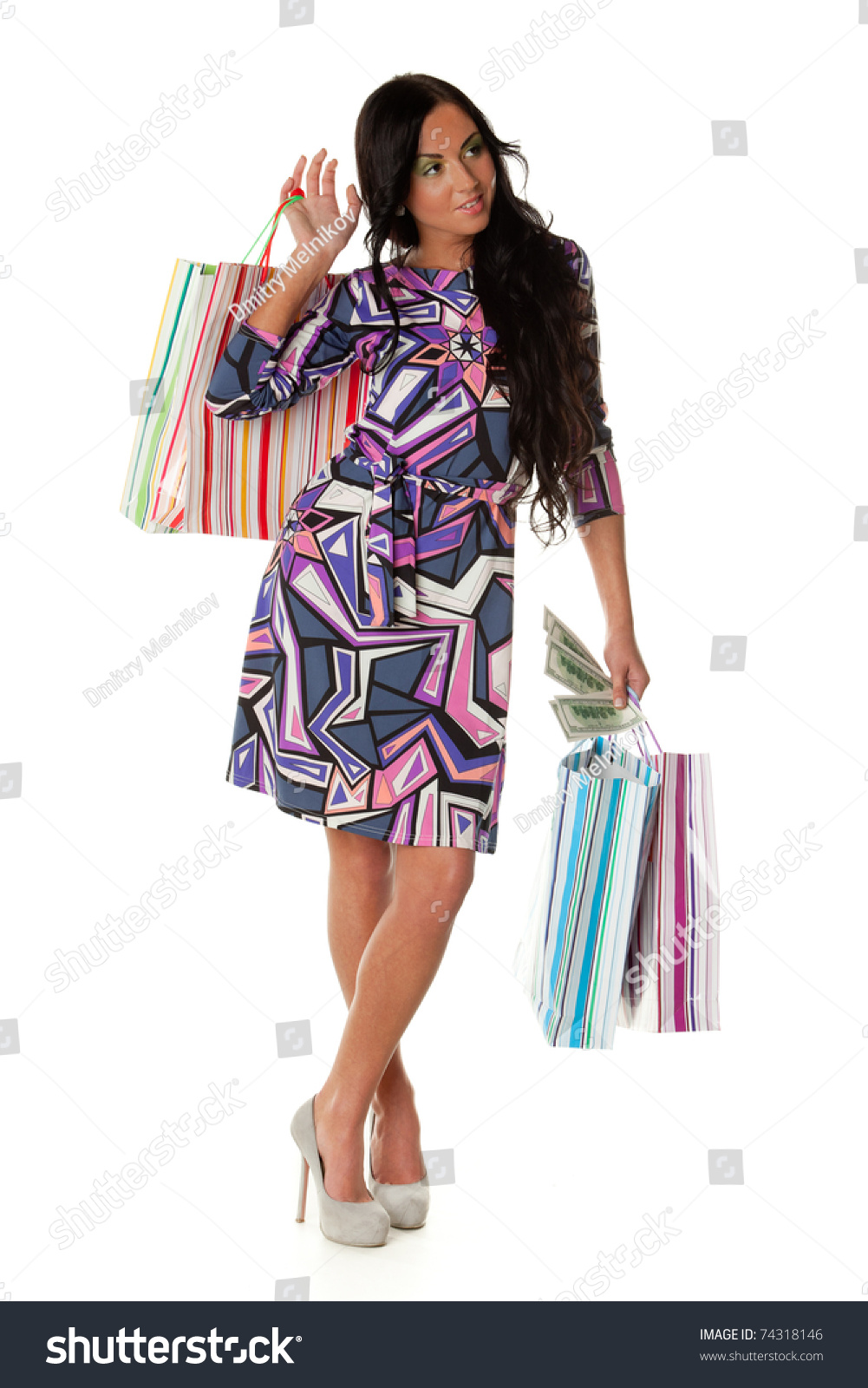 Woman posing with shopping bags isolated on white background full - Pretty Young Woman With Shopping Bags And Money On A White Background