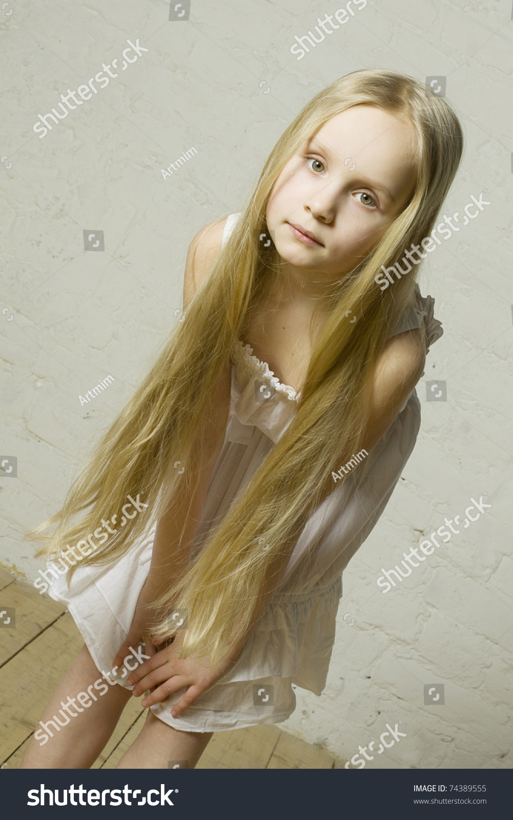 Little Beauty Royalty Free Stock Images: Little Girl Fashion Model Long Blond Stock Photo 74389555