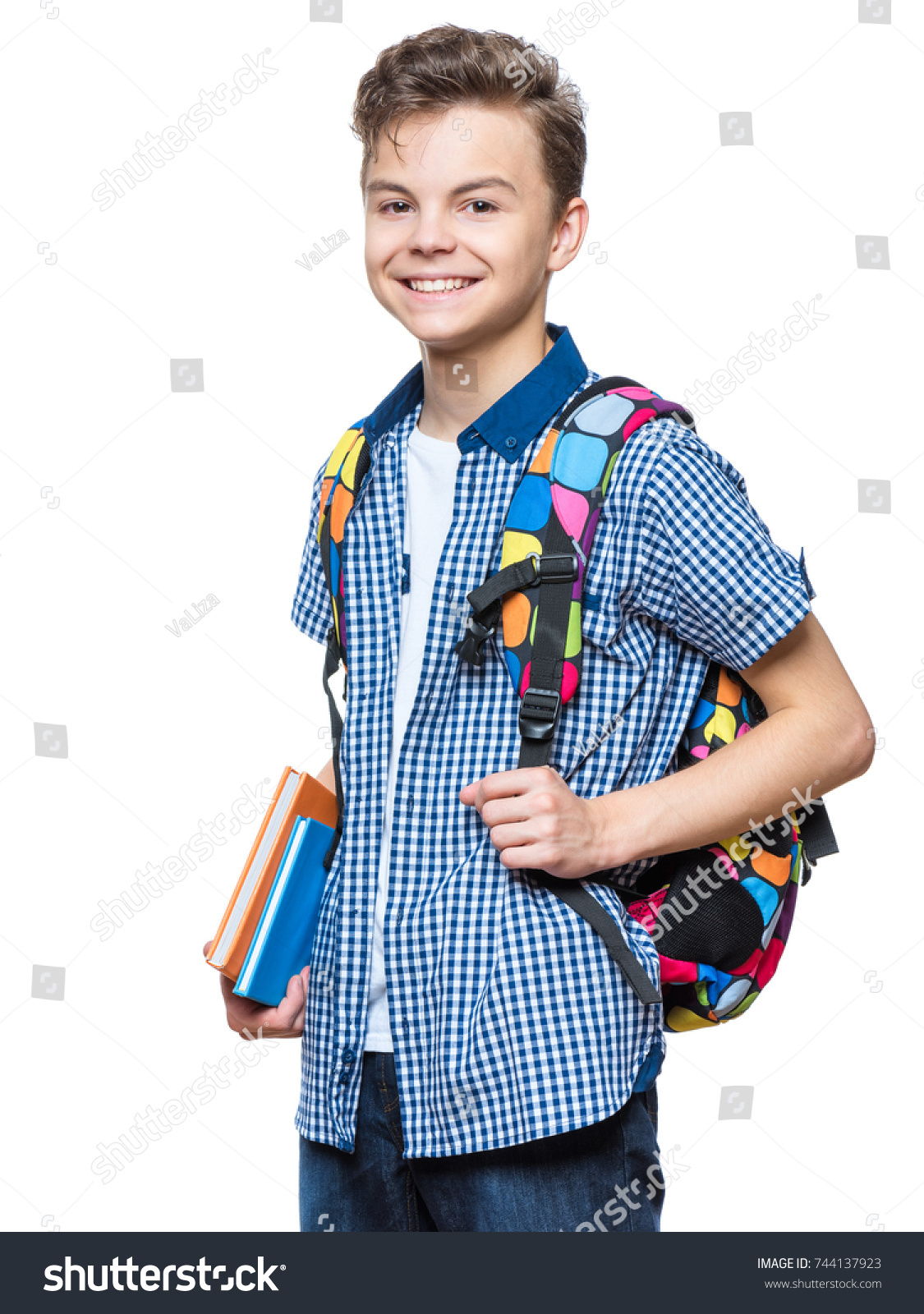 8731821ea3 Portrait of young student with school bag and books. Teenager smiling and  looking at camera. Happy teen boy