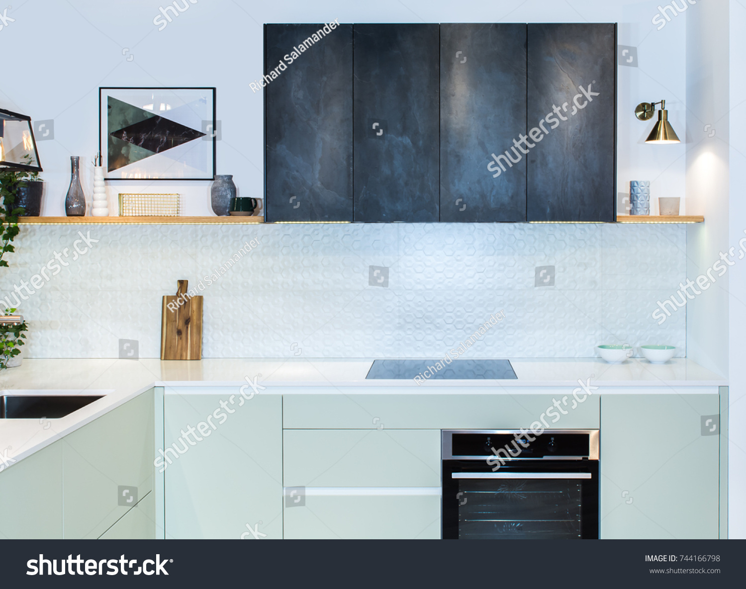 Modern home interior front view of modern kitchen in a light interior background picture european furniture design technologies project management