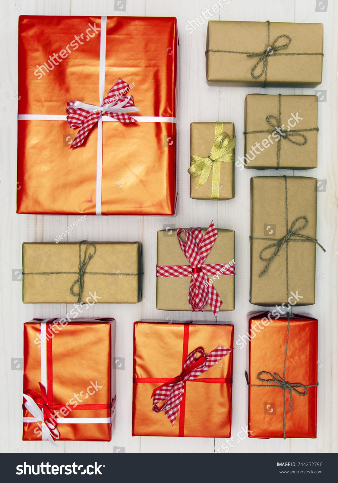 gift boxes on white wooden background top view many gifts and surprises of gifts for - How Many Gifts For Christmas