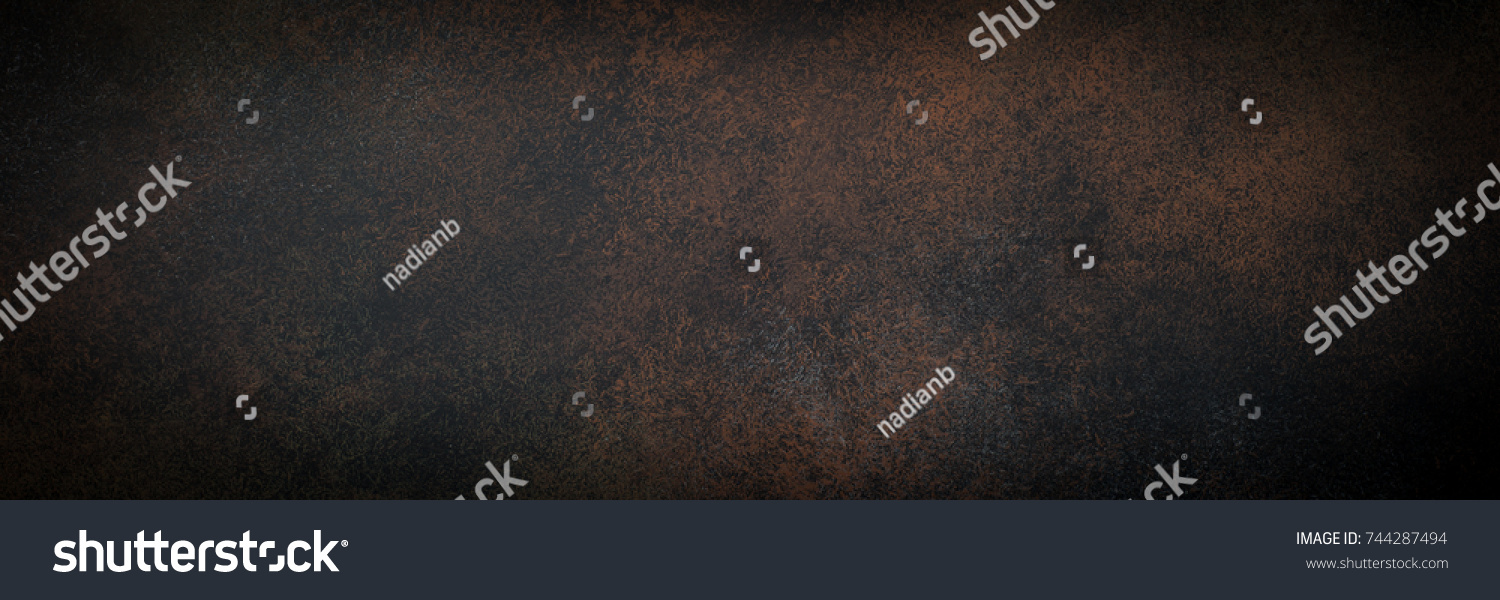 Empty brown rusty stone or metal surface texture. Long banner format. #744287494