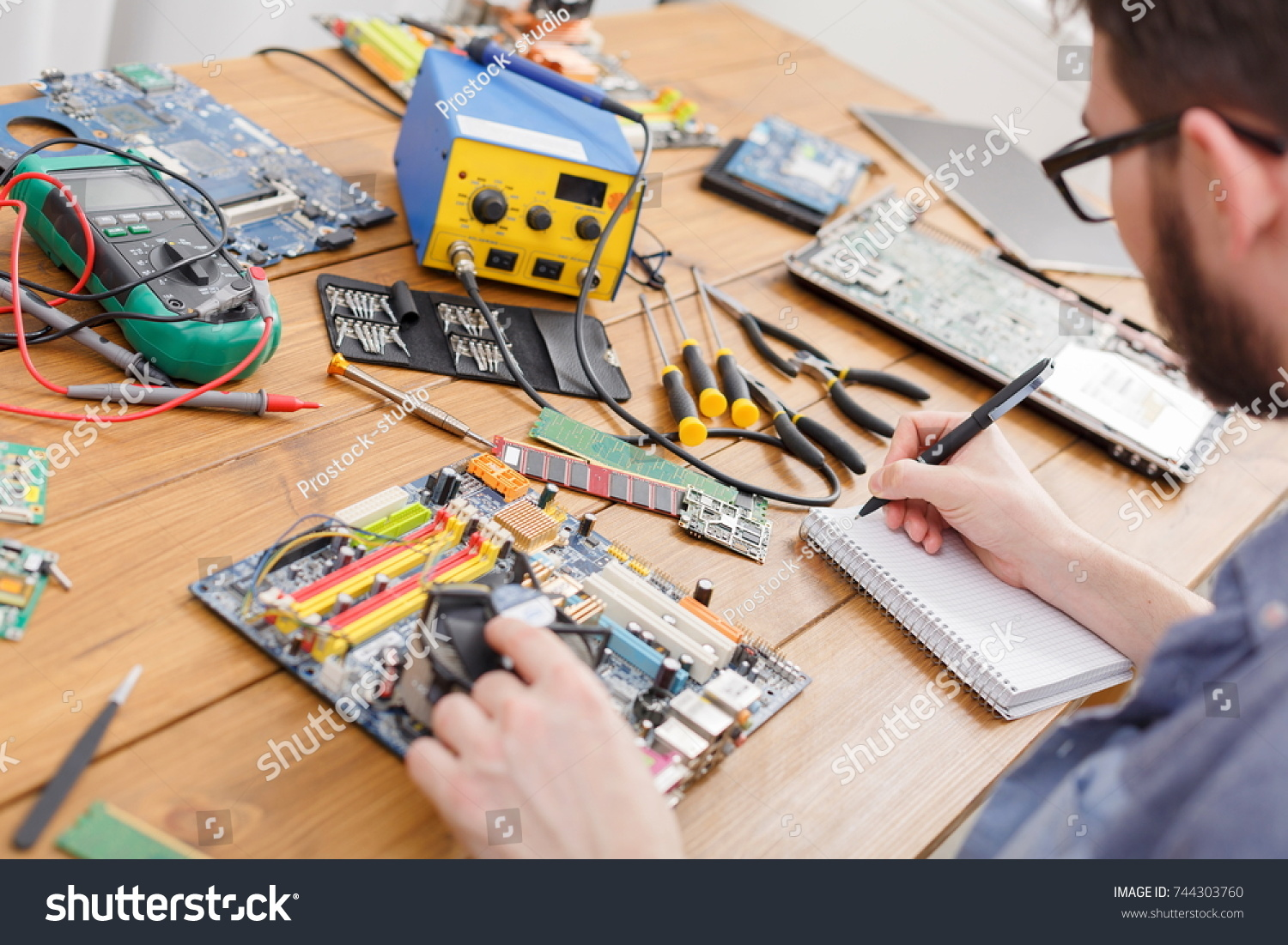 Electronic Circuit Board Inspecting Repair Shop Stock Photo Edit Notebook In Unrecognizable Engineer Fixing All Damages Of Broken Device