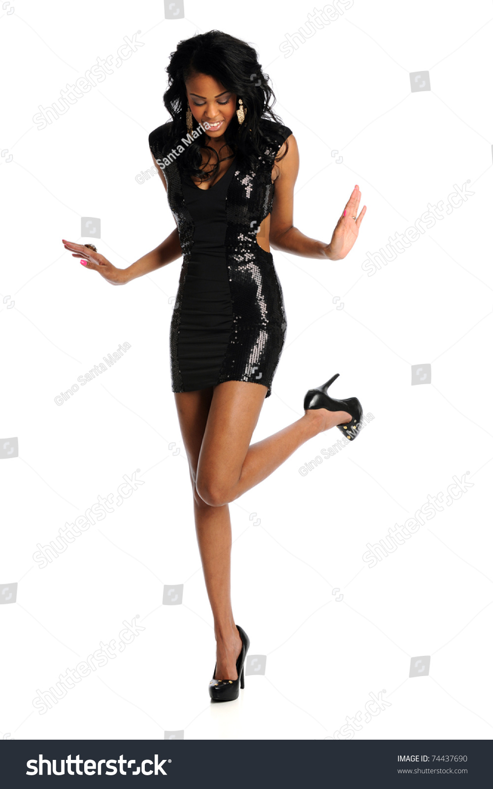 young blond fashion model wearing a black dress isolated
