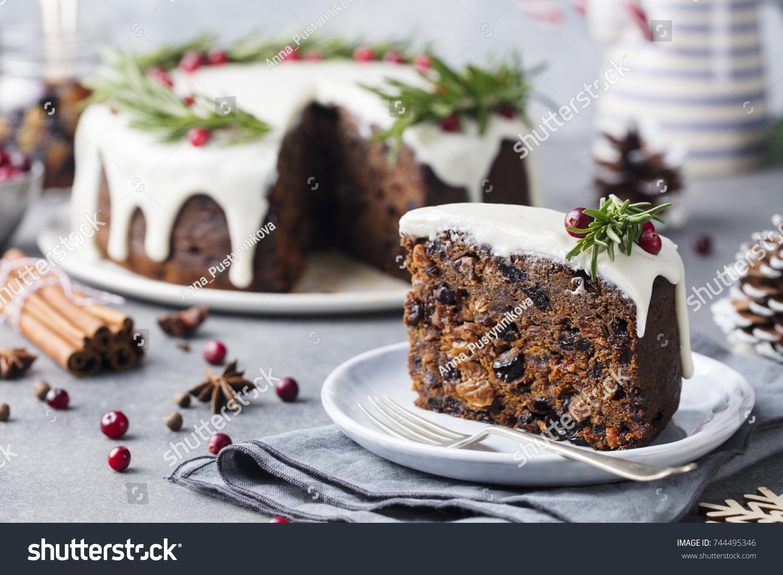christmas fruit cake pudding on white plate christmas decoration close up - Christmas Fruit Cake Decoration