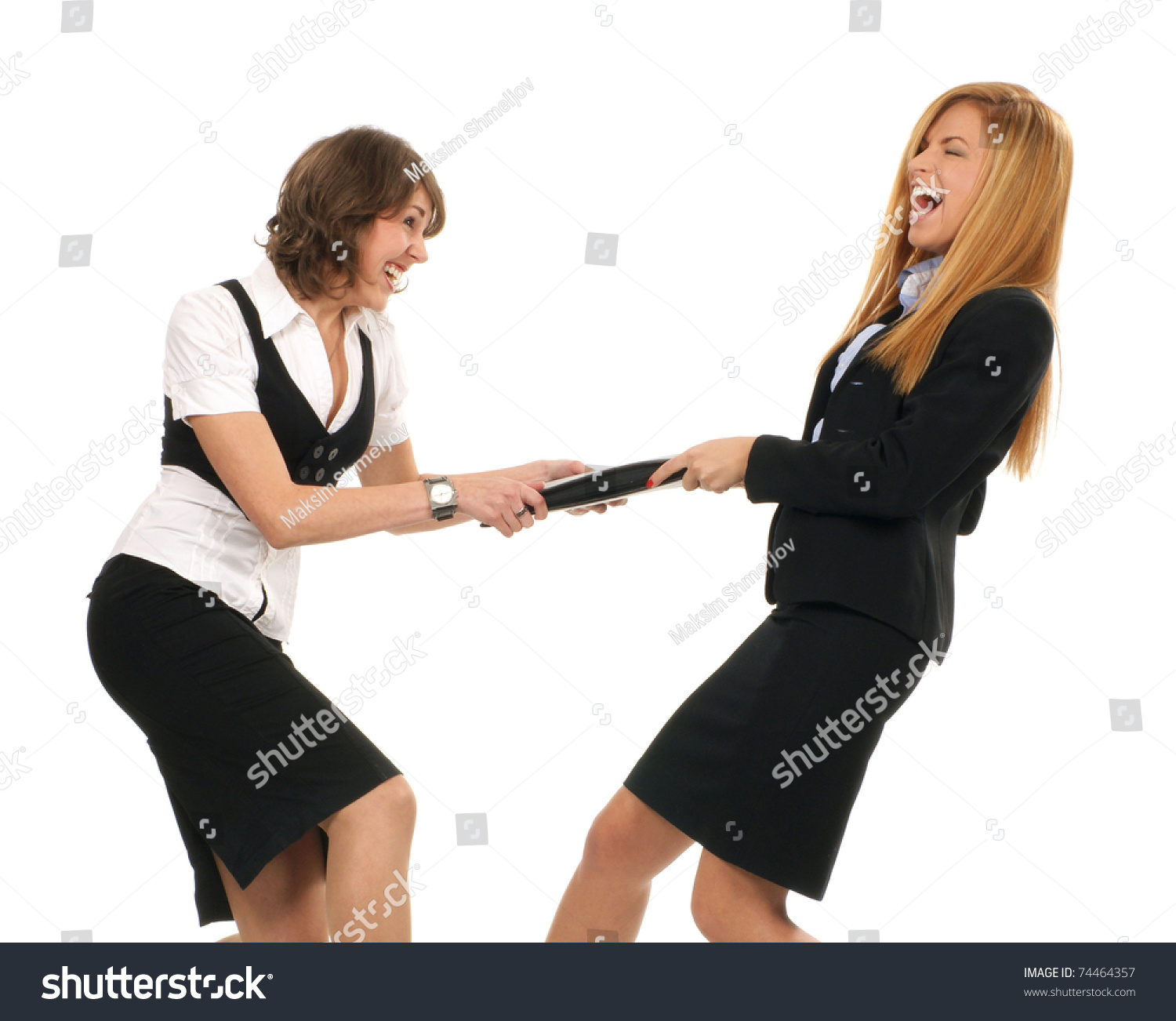Young and sexy business women are fighting isolated on white
