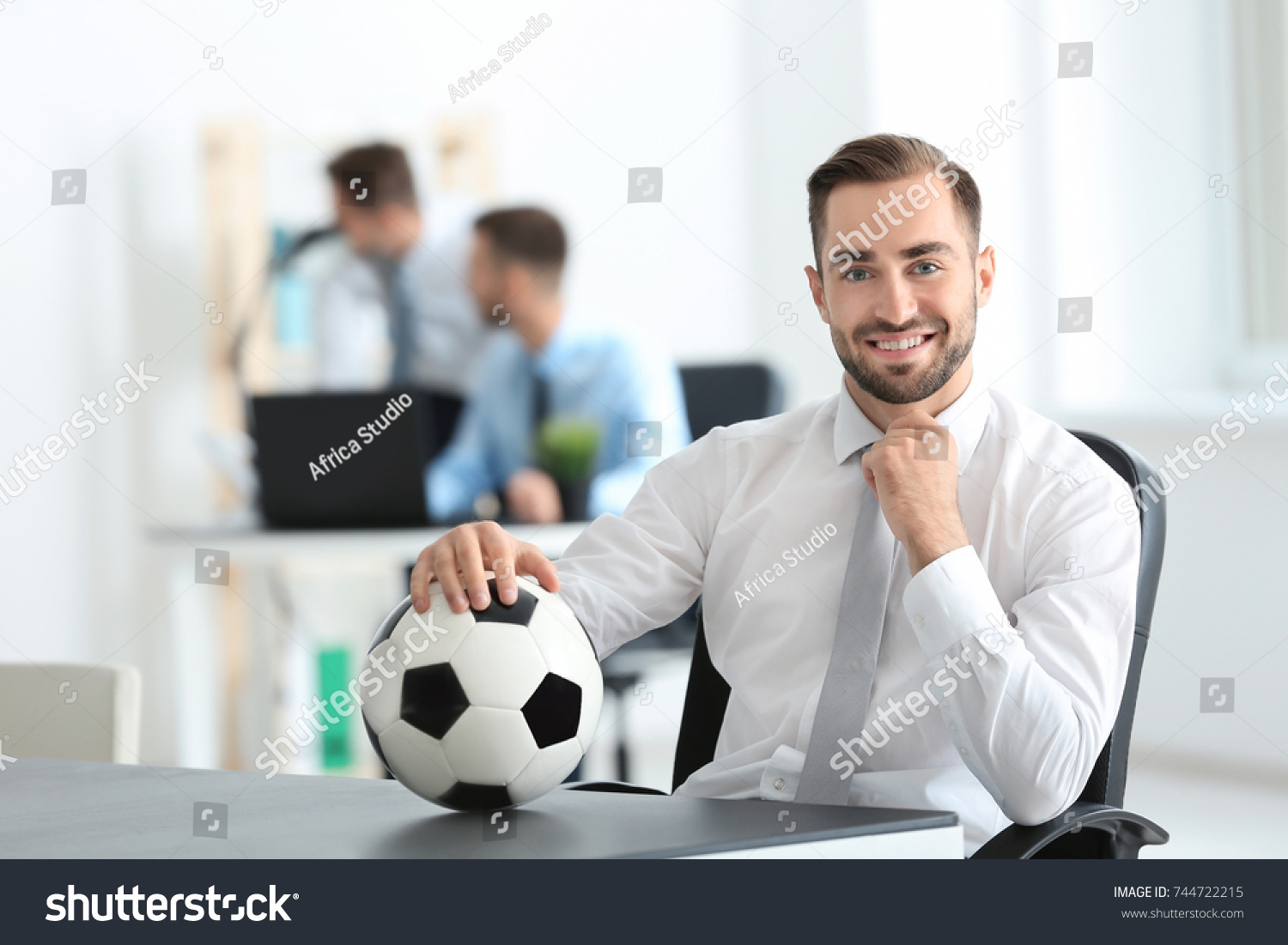 young handsome man soccer ball office stock photo royalty free 744722215 shutterstock