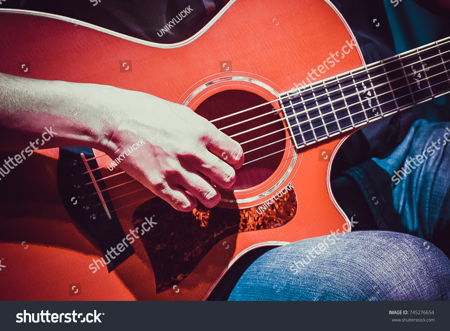 Young Hipster Man In Casual Clothing Sitting On Chair Playing Guitar Vivid Color Use For