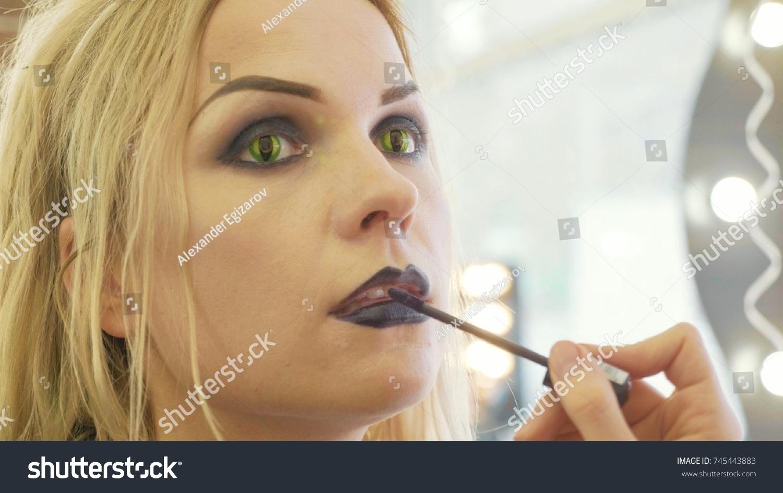 process applying halloween makeup on face stock photo (edit now