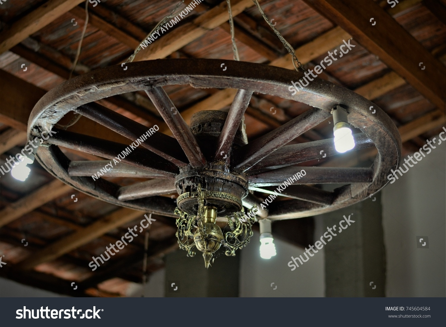 Wagon wheel chandelier country house stock photo royalty free wagon wheel chandelier in a country house arubaitofo Image collections