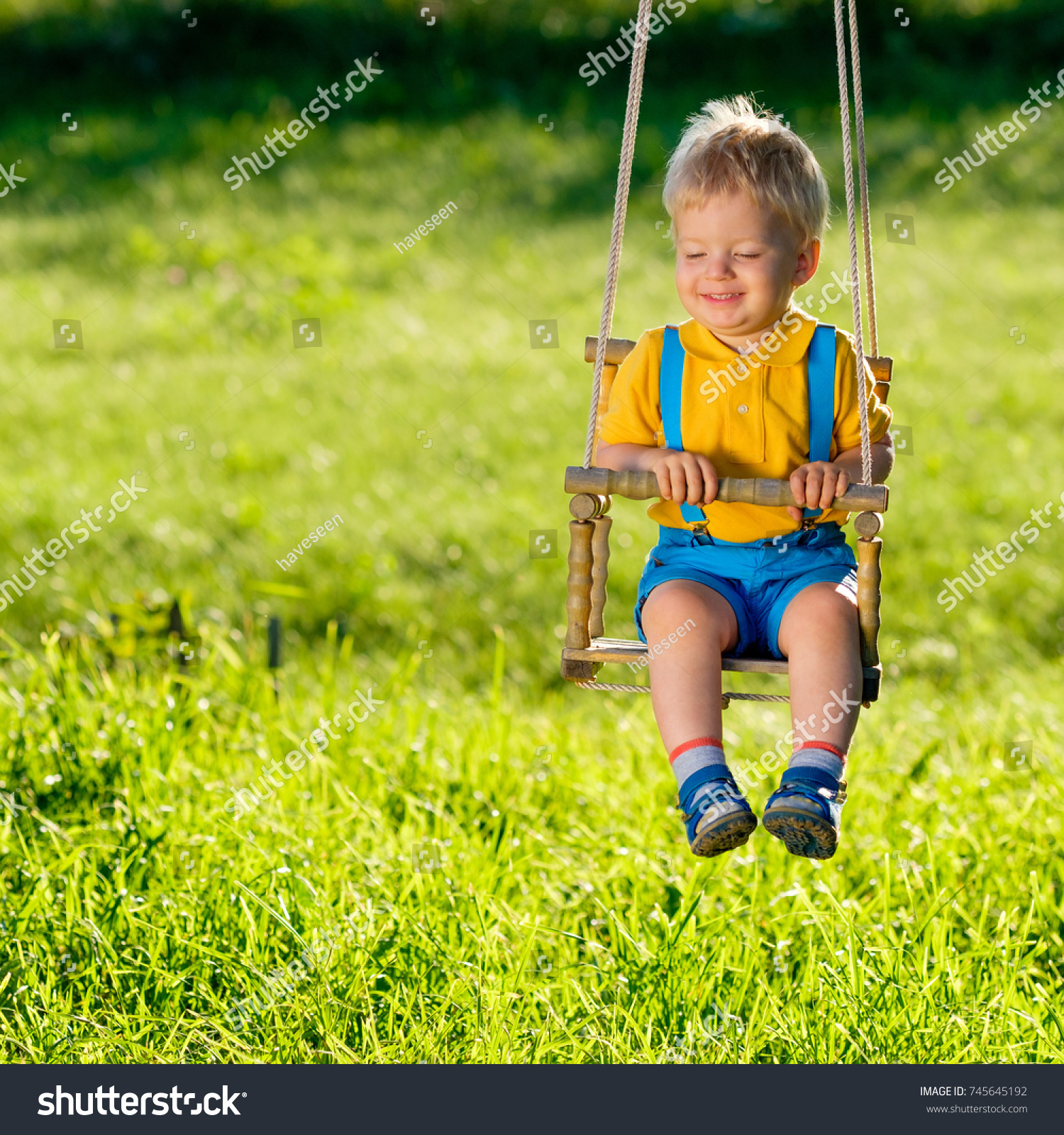 Portrait Toddler Child Swinging Outdoors Rural Stock