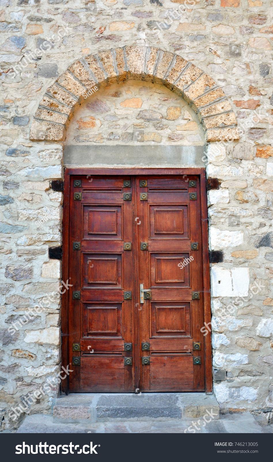 Old Wooden Door Set In Stone Wall With Red Bricks Around It Ez Canvas