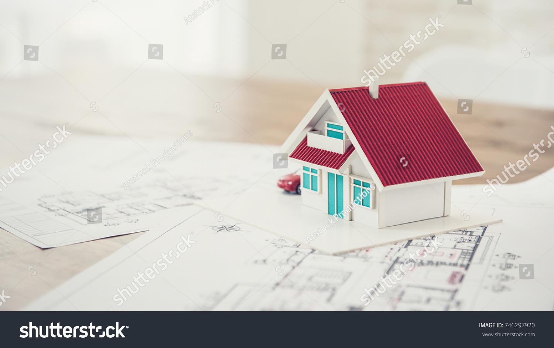 House model blueprint sample real estate stock photo 746297920 house model with blueprint sample for real estate property development malvernweather Images